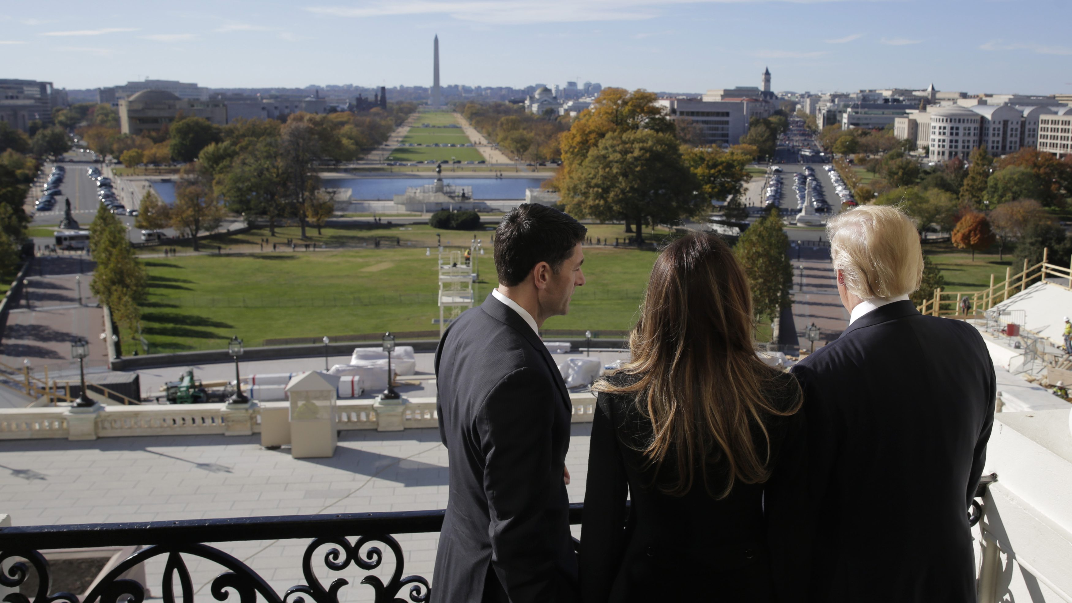 U.S. Speaker of the House Paul Ryan (R-WI) (L) shows Melania Trump and U.S. President-elect Donald Trump the Mall from the Speaker's Balcony on Capitol Hill in Washington, U.S., November 10, 2016.
