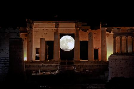 """A rising """"supermoon"""" is seen through the Propylaea, the ancient Acropolis hill gateway, in Athens, Greece November 14, 2016."""
