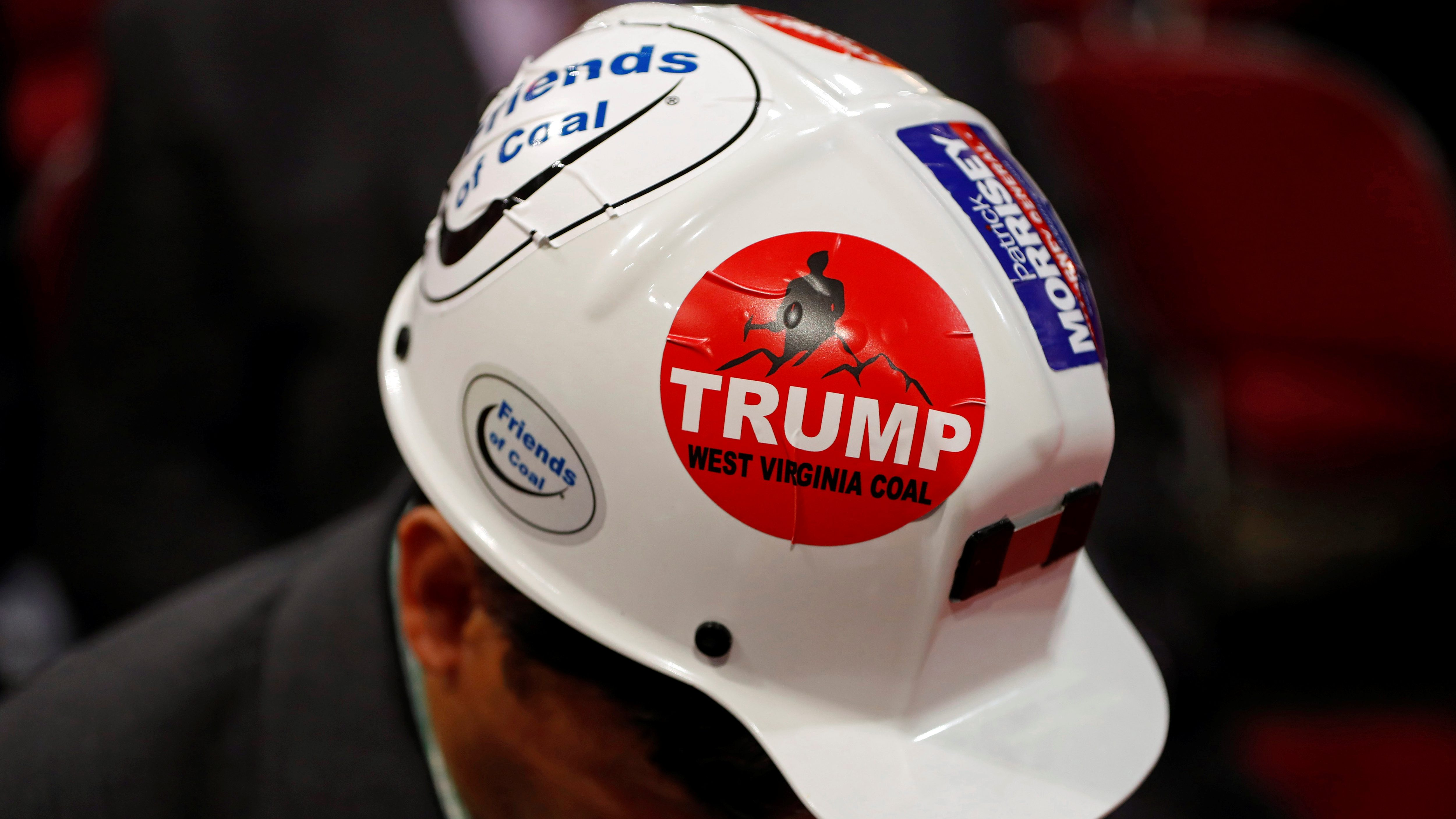 A West Virginia delegate wears a Trump sticker on his hard hat during the second day of the Republican National Convention in Cleveland