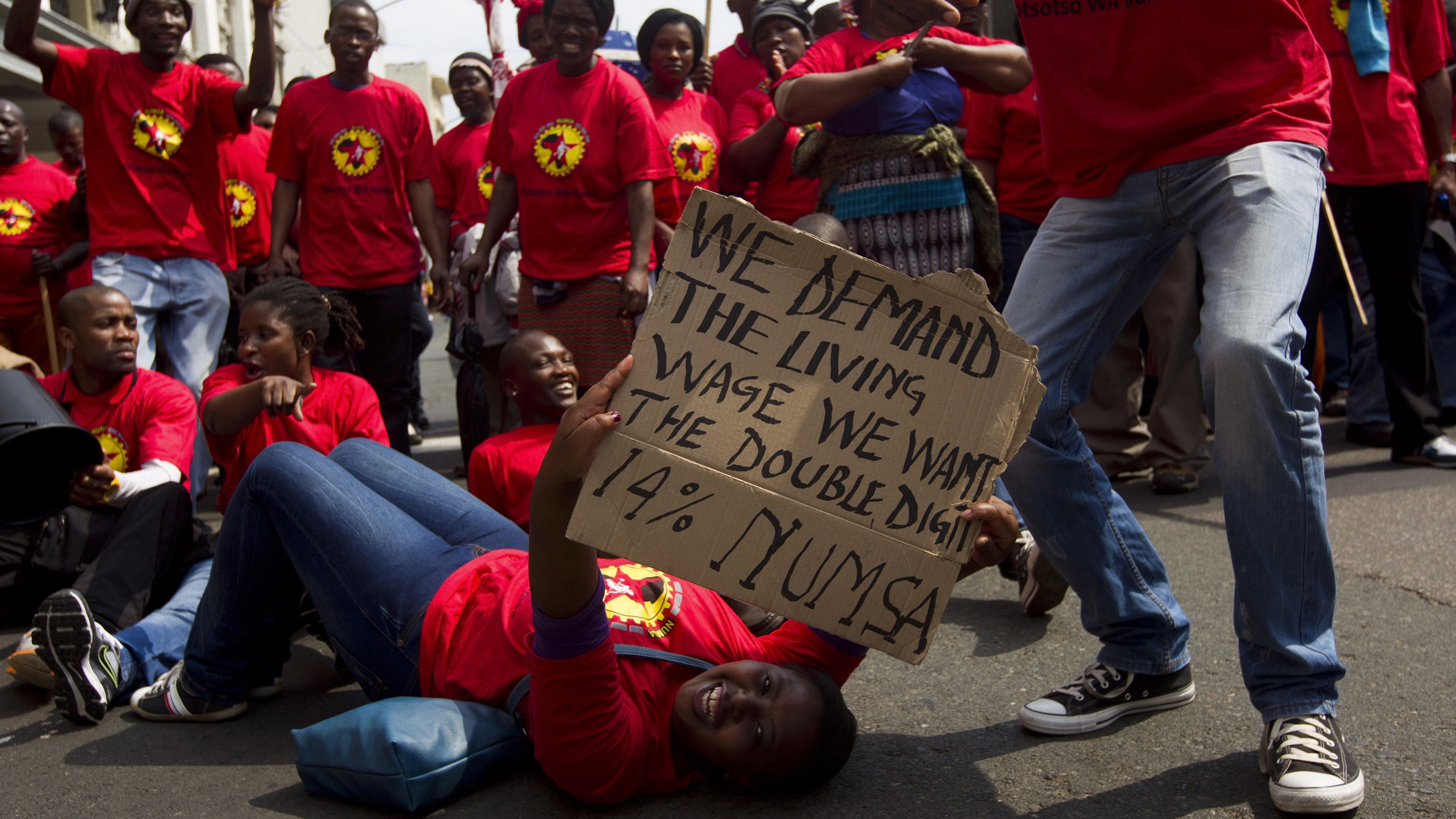 Members of the National Union of Metalworkers of South Africa (NUMSA) march through the Durban central business district, September 12, 2013. NUMSA, which represents fuel pump attendants, continues their nationwide strike to demand better wages.  REUTERS/Rogan Ward (SOUTH AFRICA - Tags: BUSINESS EMPLOYMENT) - RTX13INV
