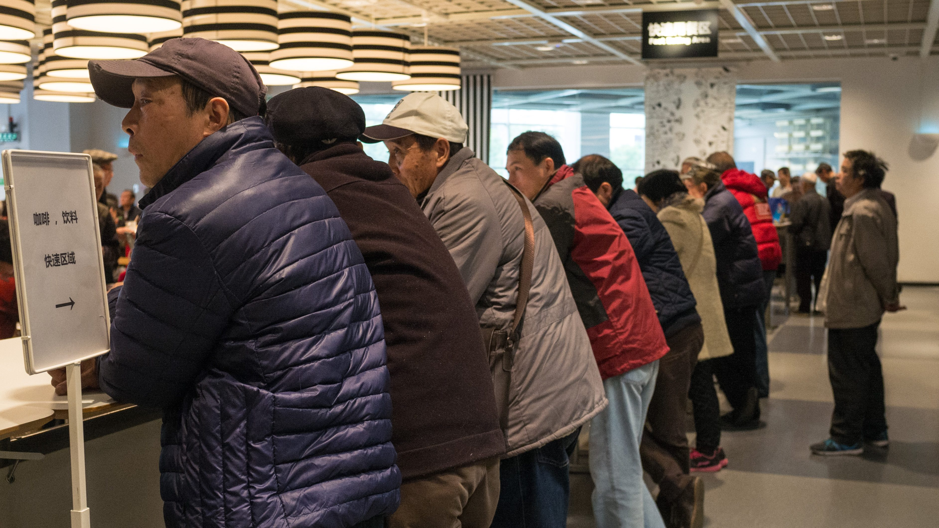 Elderly patrons stands outside a Shanghai Ikea's cafe area on Nov. 29.