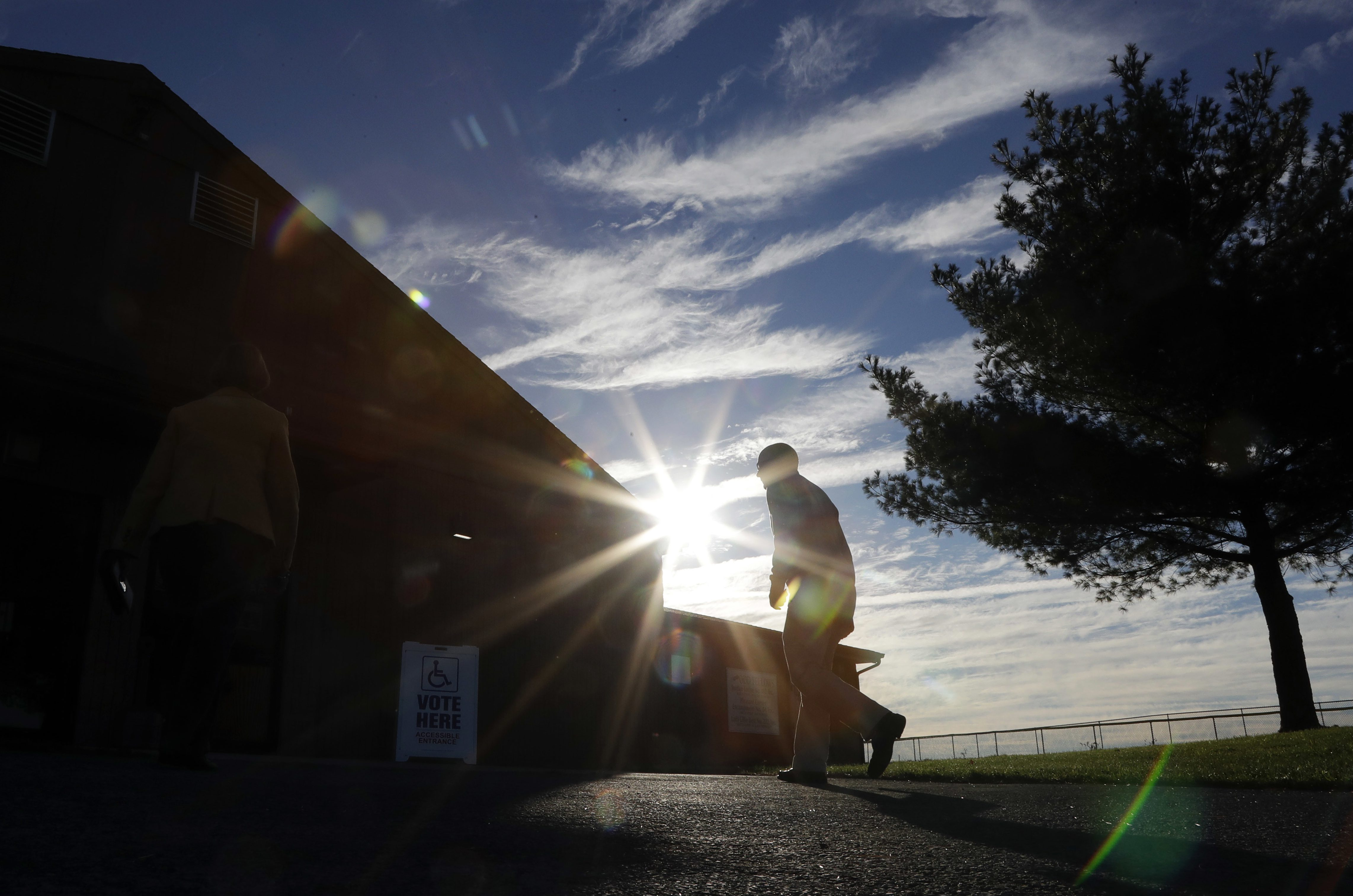 A voters walks to a polling place at the Schnecksville Fire Company, Tuesday, Nov. 8, 2016, in Schnecksville, Pa.