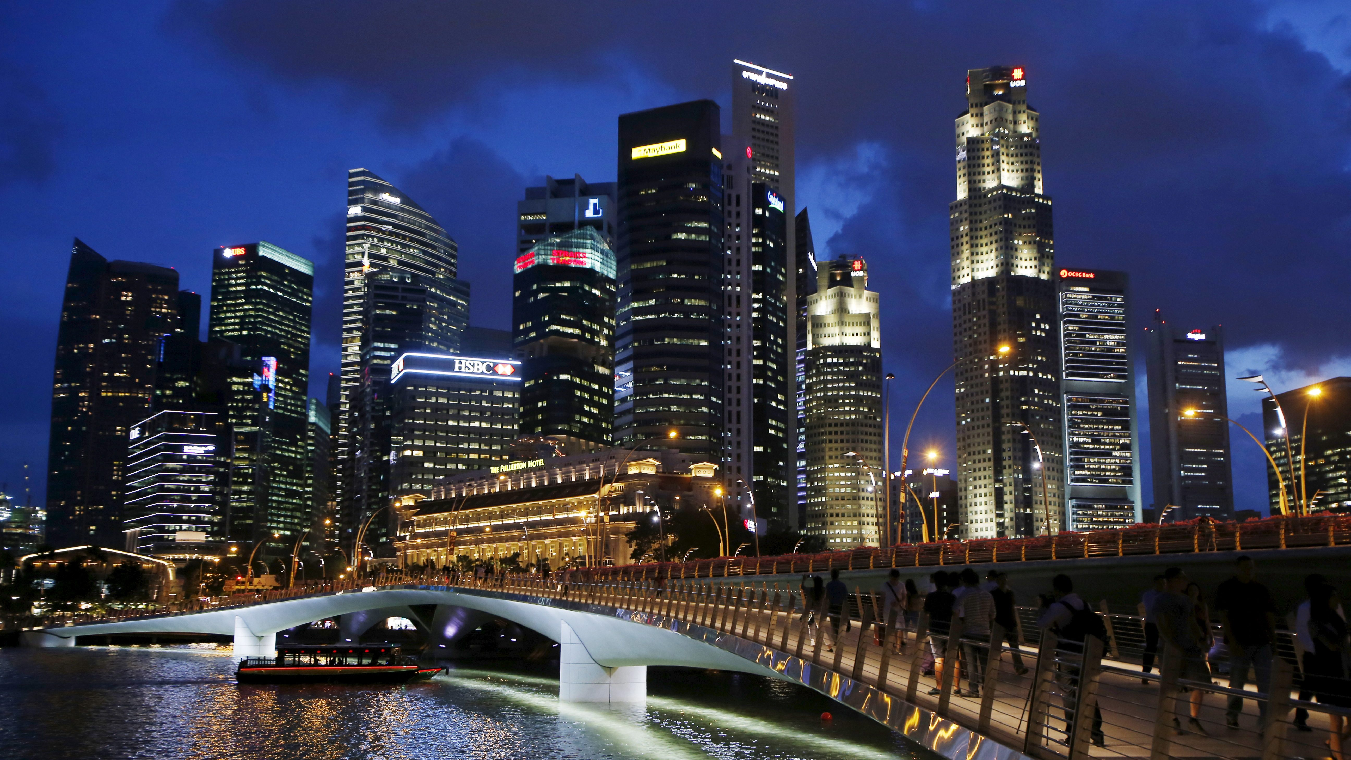 A view of the central business district in Singapore April 9, 2015. When Singapore celebrated its 50th birthday as an independent country in August, the city state bore little resemblance to the tiny island nation that was expelled from Malaysia in 1965. Its physical stature has swollen by 20 percent thanks to one of the world's most aggressive land reclamation drives.