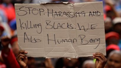 Two white men appear in a South African court after a video shows them forcing a black man into a coffin