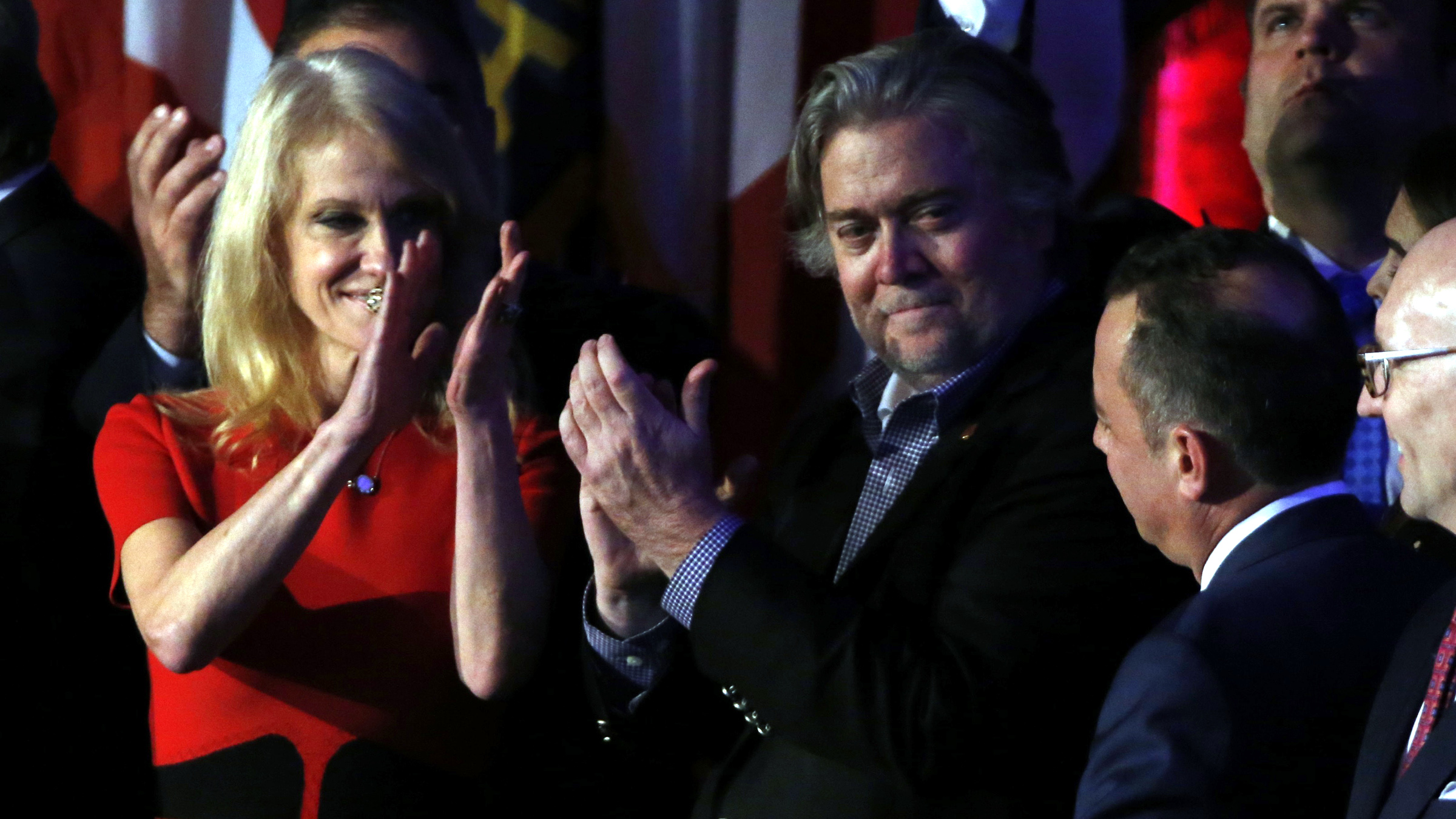 Trump campaign manager Kellyanne Conway (L), campaign CEO Stephen Bannon (C) and Republican National Committee Chair Reince Priebus (R) celebrate as Republican U.S. presidential nominee Donald Trump speaks at his election night rally in Manhattan, New York, U.S., November 9, 2016.