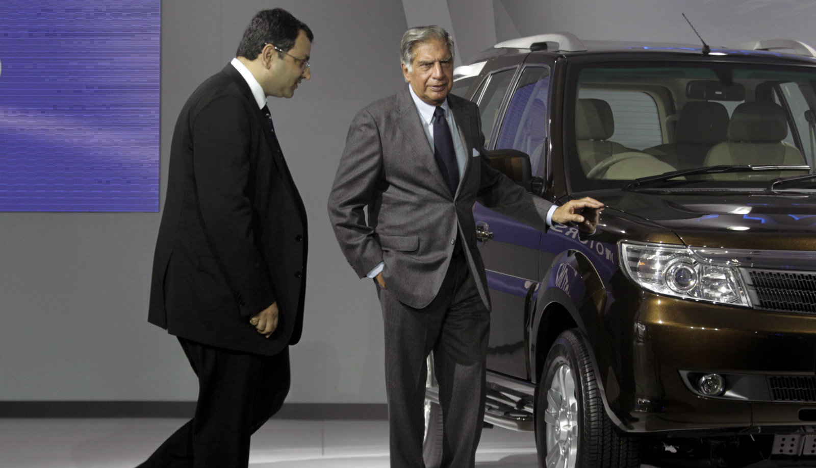 Tata Sons Chairman Ratan Tata, center, and deputy chairman Cyrus Mistry, left, pose near a Tata Safari during a press preview at the India Auto Expo, in New Delhi, India, Thursday, Jan. 5, 2012. The five day long automobile event begins Saturday.