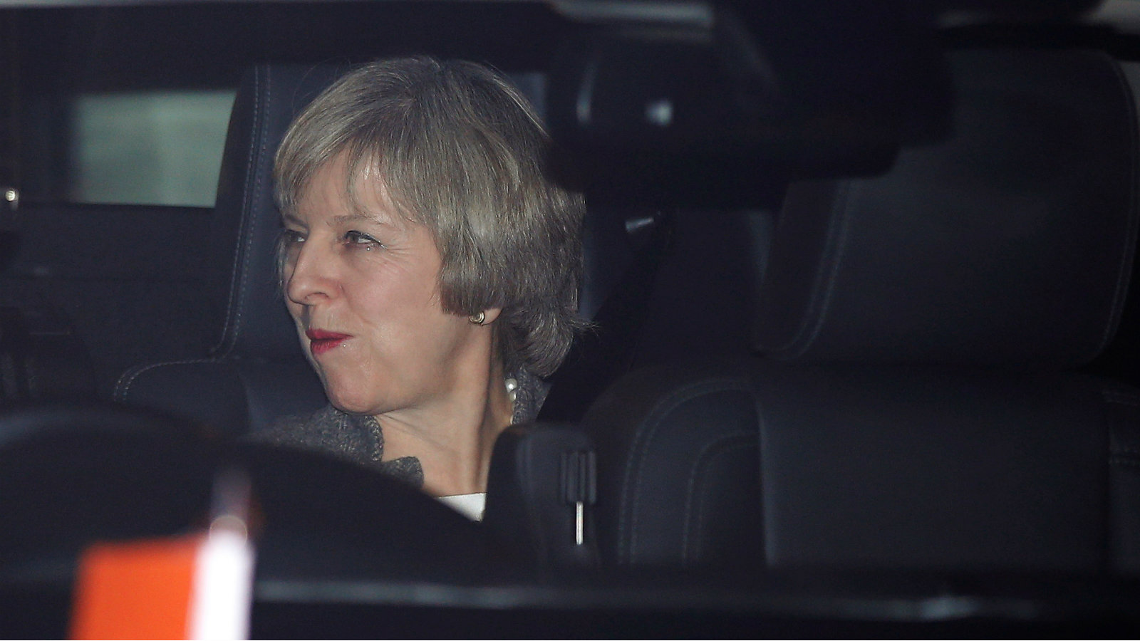 Britain's Prime Minister Theresa May sits in her car after her arrival at the airport in New Delhi, India, November 6, 2016.