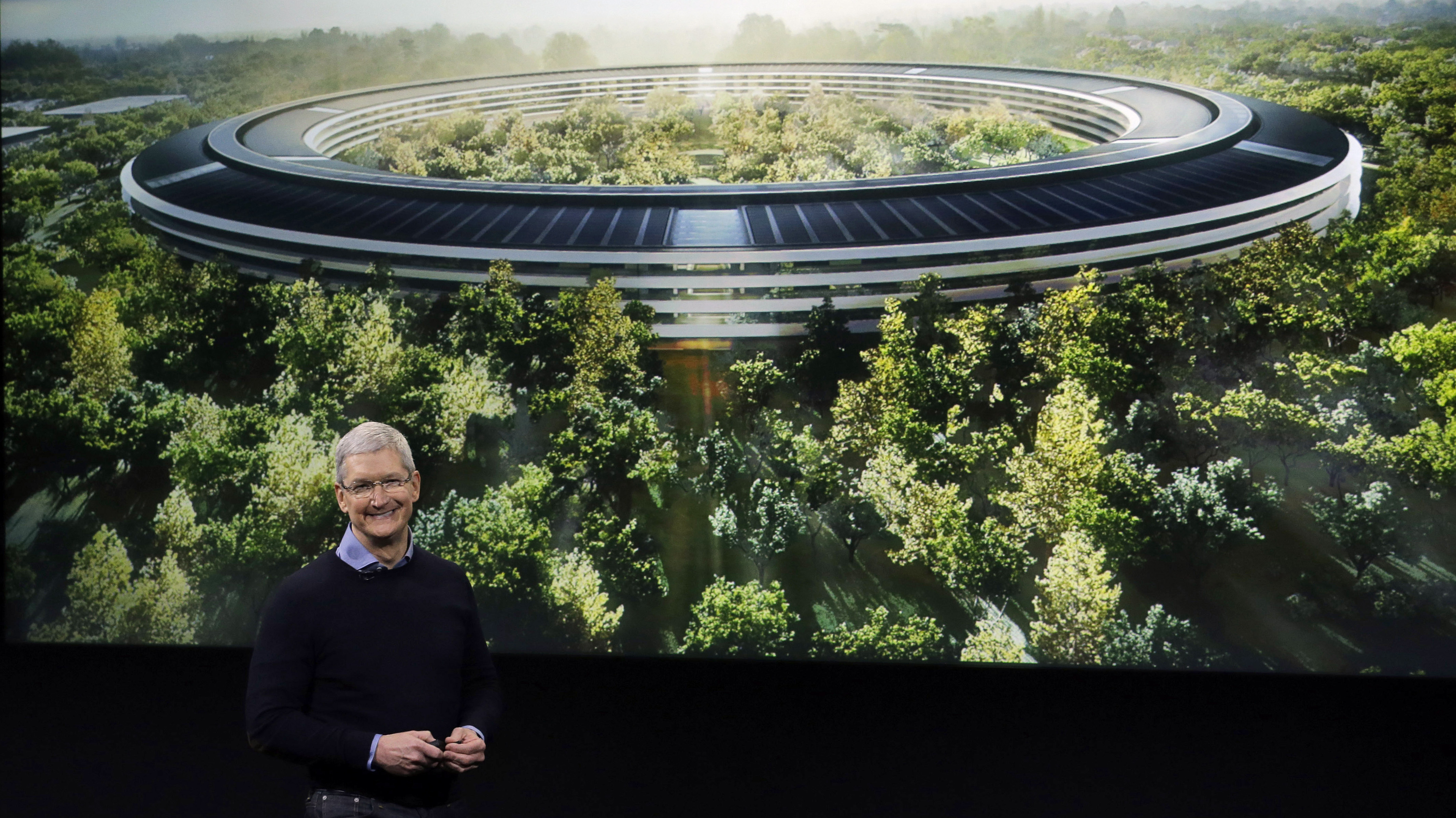 Apple CEO Tim Cook, discusses the new Apple campus at an event to announce new products at Apple headquarters Monday, March 21, 2016, in Cupertino, Calif. (AP Photo/Marcio Jose Sanchez)