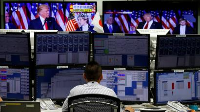 Foreign exchange trader at their desk as Trump wins