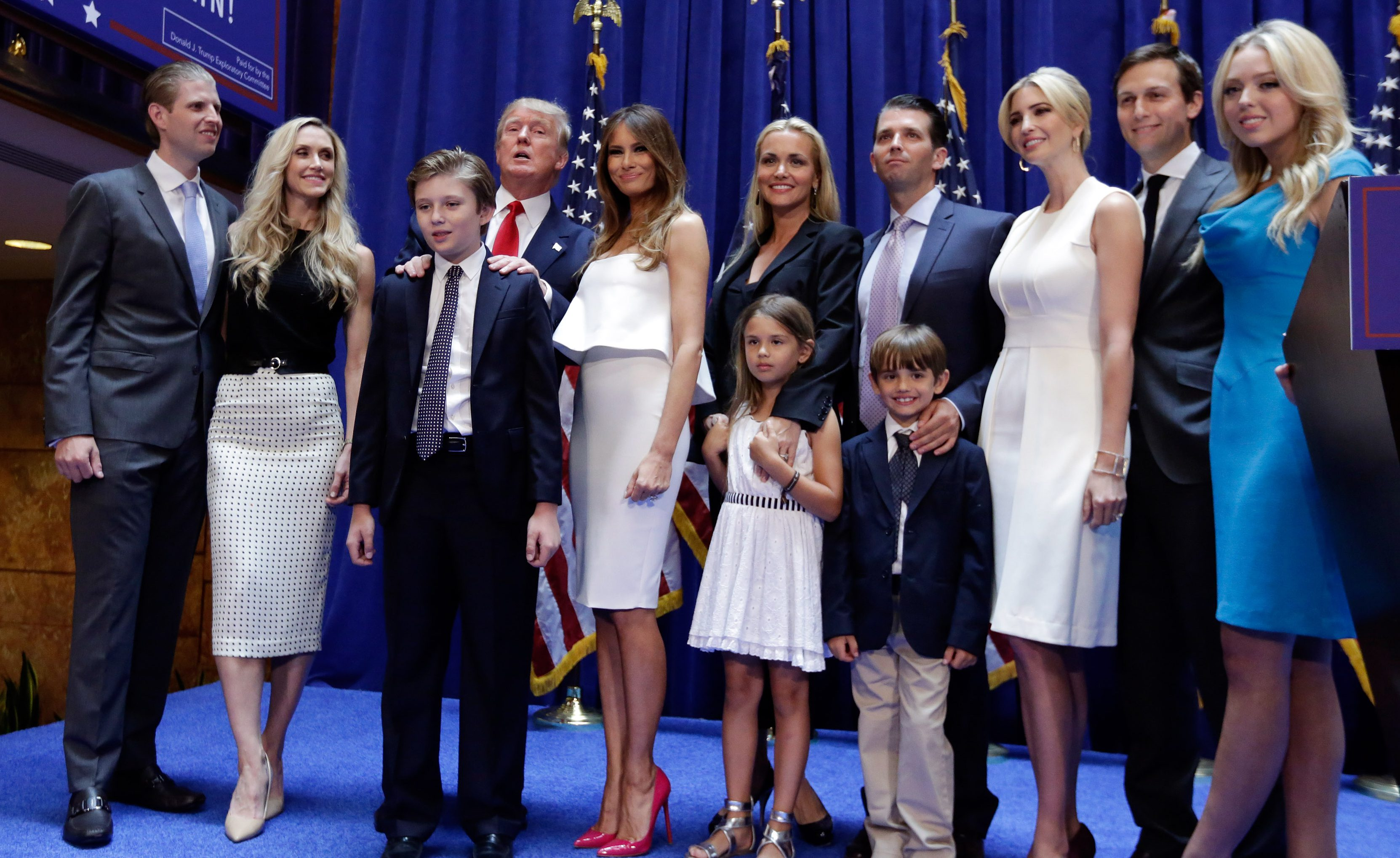In this June 16, 2015 file photo, Donald Trump, fourth left, poses with his family after his announcement that he will run for president of the United States, in the lobby of Trump Tower, New York,  Tuesday, June 16, 2015. From lef are: son Eric Trump, with his wife Lara Yunaska; Donald Trump's son Barron Trump, wife Melania Trump; Vanessa Haydon and her husband Donald Trump Jr.; daughter Ivanka Trump with her husband Jared Kushner; daughter Tiffany Trump. In the front row are Kai Trump and Donald Trump III, children of Donald Trump Jr.