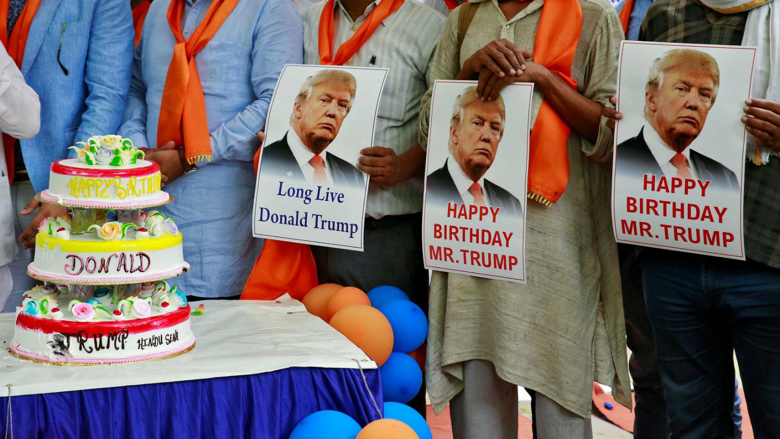Members of Hindu Sena, a right wing Hindu group, celebrate  Donald Trump's birthday in New Delhi, India in June 2016.