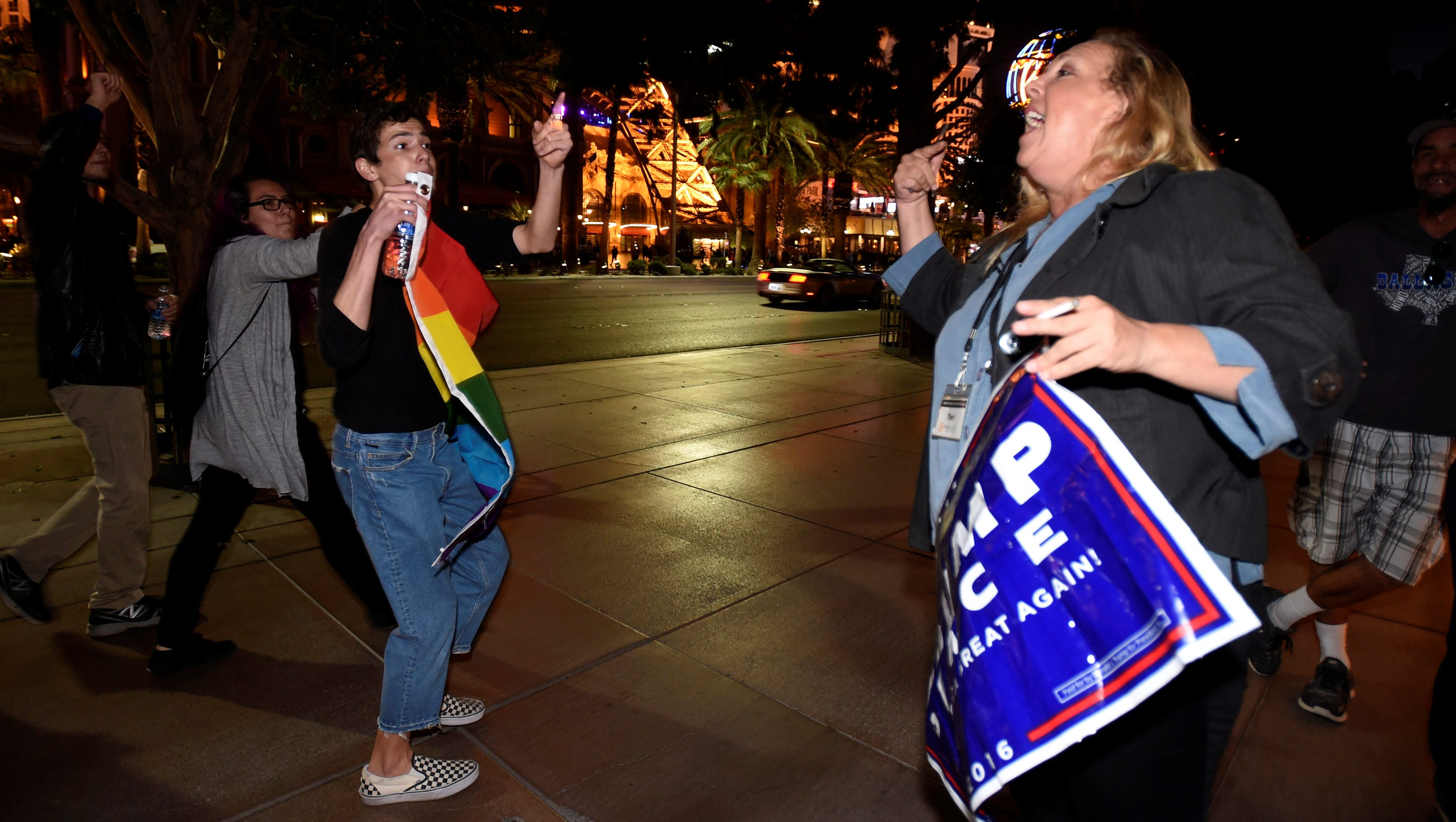 Pino Alessi (L) of Las Vegas argues with a Donald Trump supporter during a protest march against the election of Trump as President of the United States, along the Las Vegas Strip in Las Vegas, Nevada, U.S.