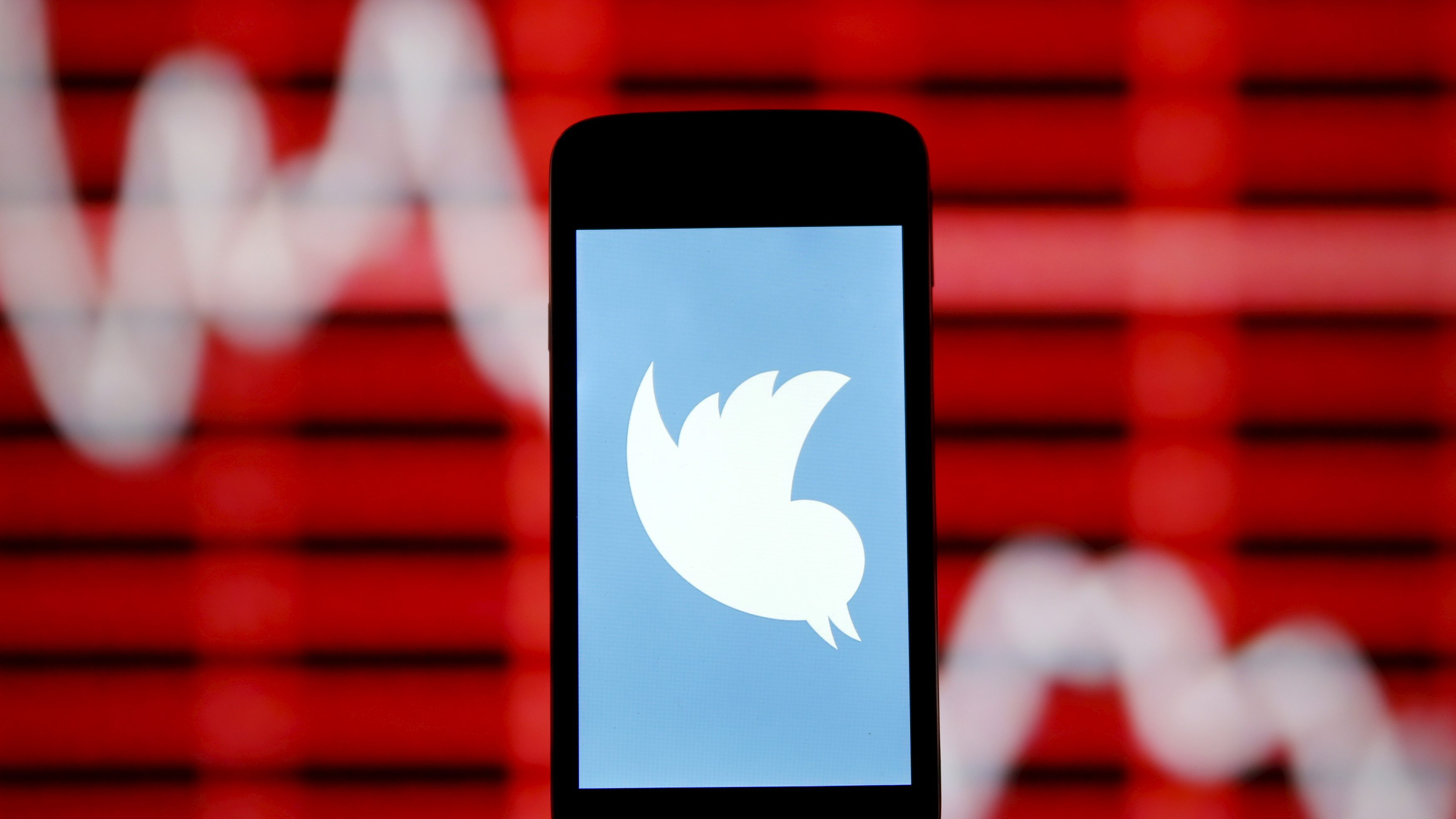 The Twitter logo is shown on smartphone in front of a displayed stock graph in central Bosnian town of Zenica, Bosnia and Herzegovina, in this April 29, 2015 photo illustration.  Twitter Inc reported quarterly revenue that fell short of Wall Street estimates and cut its full-year forecast because of weak demand for its new direct response advertising, sending shares down as much as 24 percent on Tuesday. User growth was off to a slow start in April, the company said, even though it hit its own target for the just-ended first quarter.Twitter forecast 2015 revenue of $2.17 billion to $2.27 billion, down from its earlier forecast of $2.3 billion to $2.35 billion. Analysts on average had been expecting $2.37 billion. Twitter said its new direct response ads, intended to encourage actions such as clicking on a link to an advertiser's website, did not produce the revenue expected.