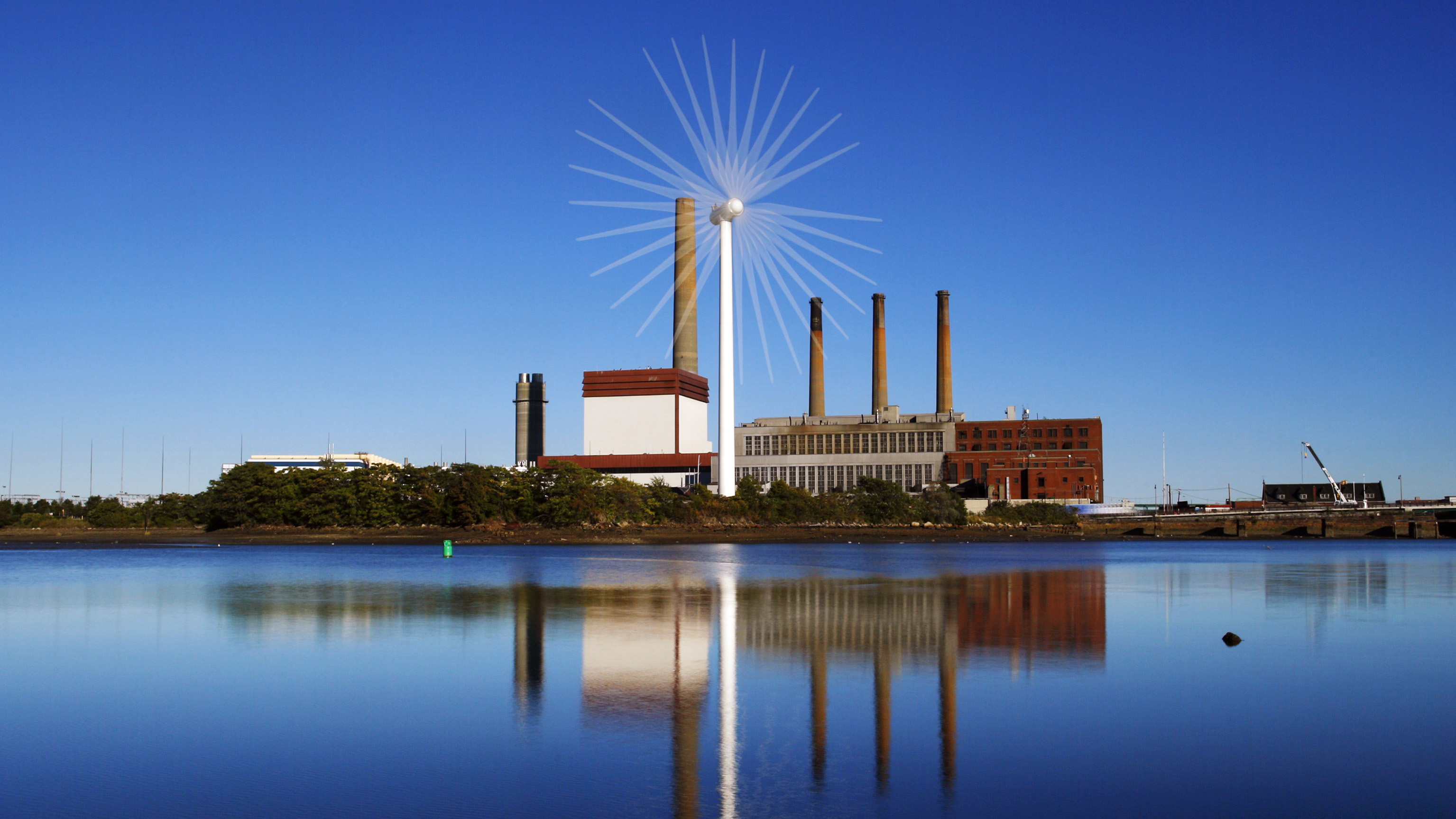 Wind turbine in front of oil and gas power plant