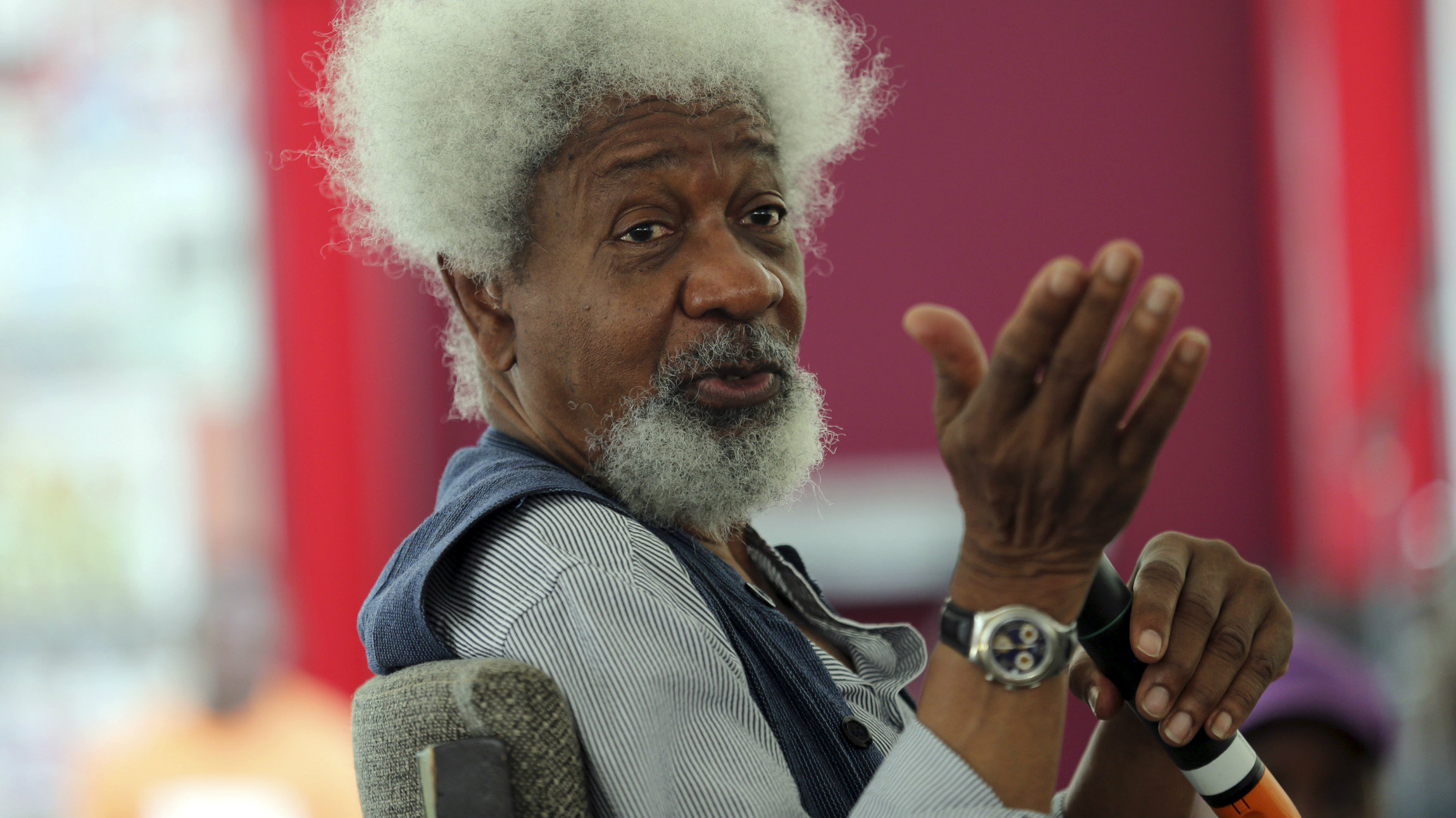 Nobel laureate Wole Soyinka speaks to pupils during a mentoring session at the Lagos Book and Art Festival November 15, 2014.