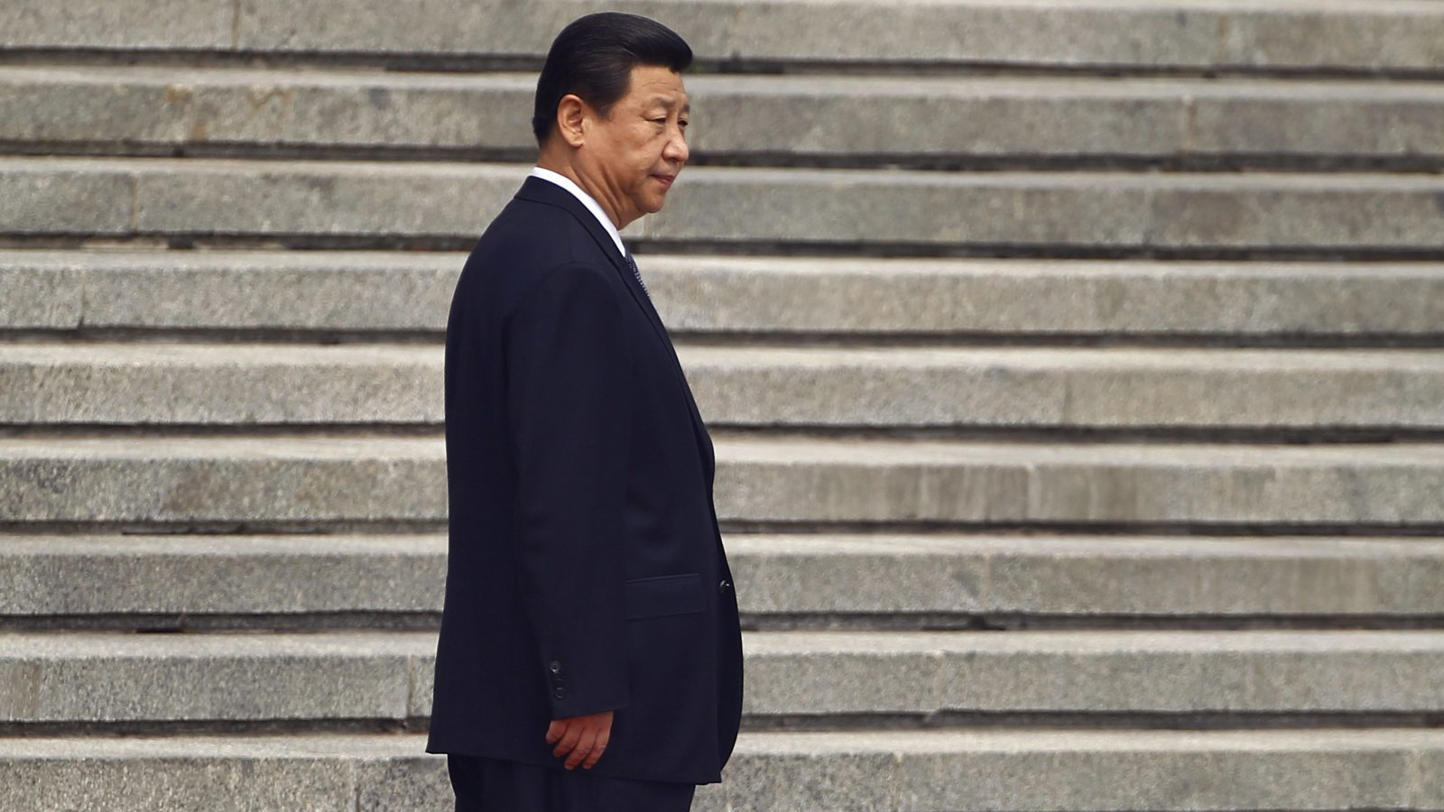 China's President Xi Jinping on some steps.