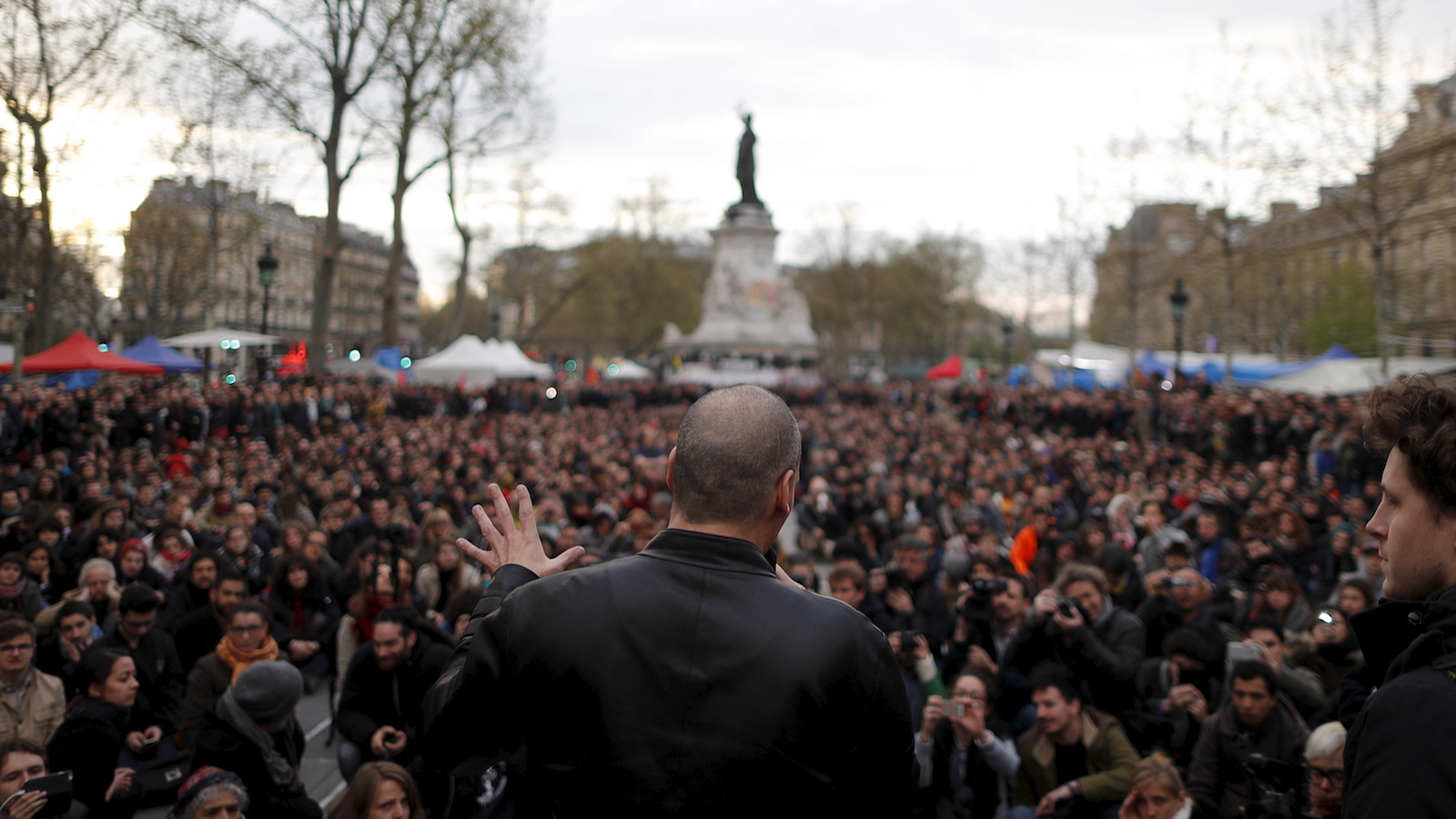 """Former Greek Finance Minister Yanis Varoufakis speaks in front of supporters of social media-driven movement """"Nuit Debout"""" (Up All Night), during their daily gathering on the Place de la Republique in Paris, France, against a French labour law proposal, April 16, 2016. REUTERS/Christian Hartmann  - RTX2A9L1"""