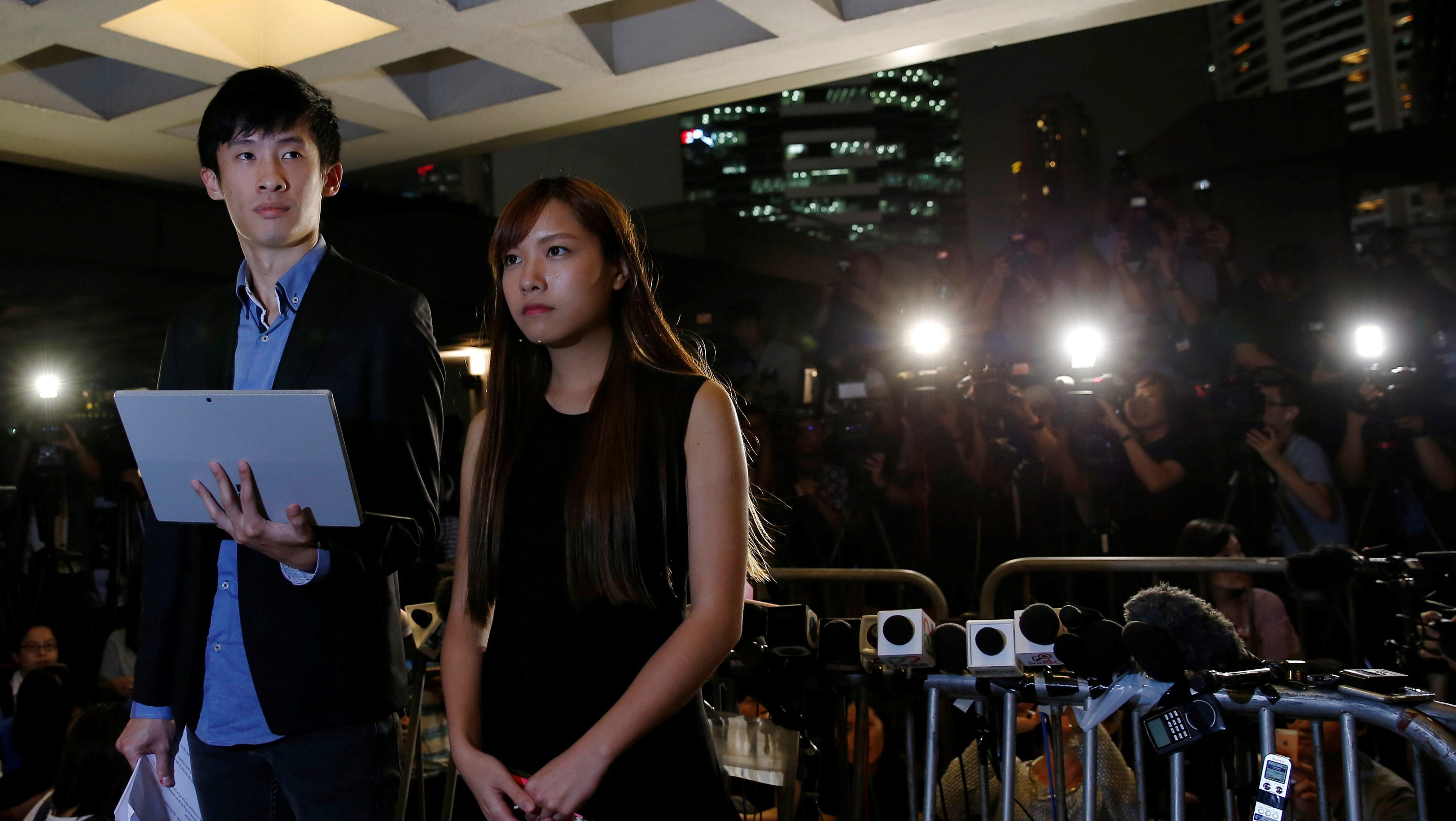 Democratically-elected legislators Yau Wai-Ching and Baggio Leung (L) speak to media after a High Court disqualified them from taking office in Hong Kong, China November 15, 2016. REUTERS/Tyrone Siu - RTX2TQZ5