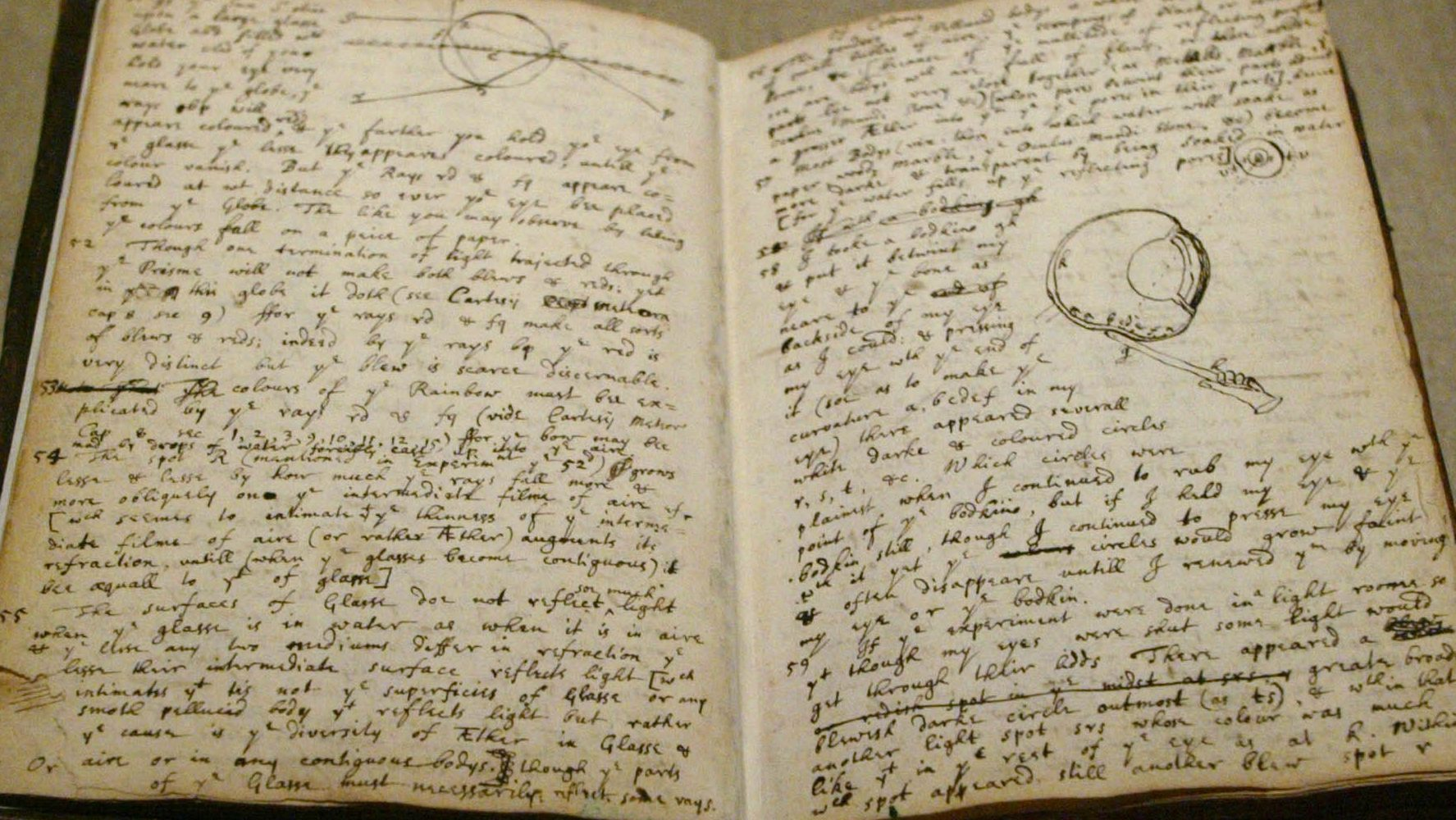 "A notebook belonging to Isaac Newton describing an experiment he conducted on his himself placing a sharp instrument between his eye and the bone in order to induce the sensation of color is on display at ""The Newtonian Moment"" exhibit at the New York Public Library, during a preview Thursday, Sept. 30, 2004 in New York. (AP Photo/Mary Altaffer)"