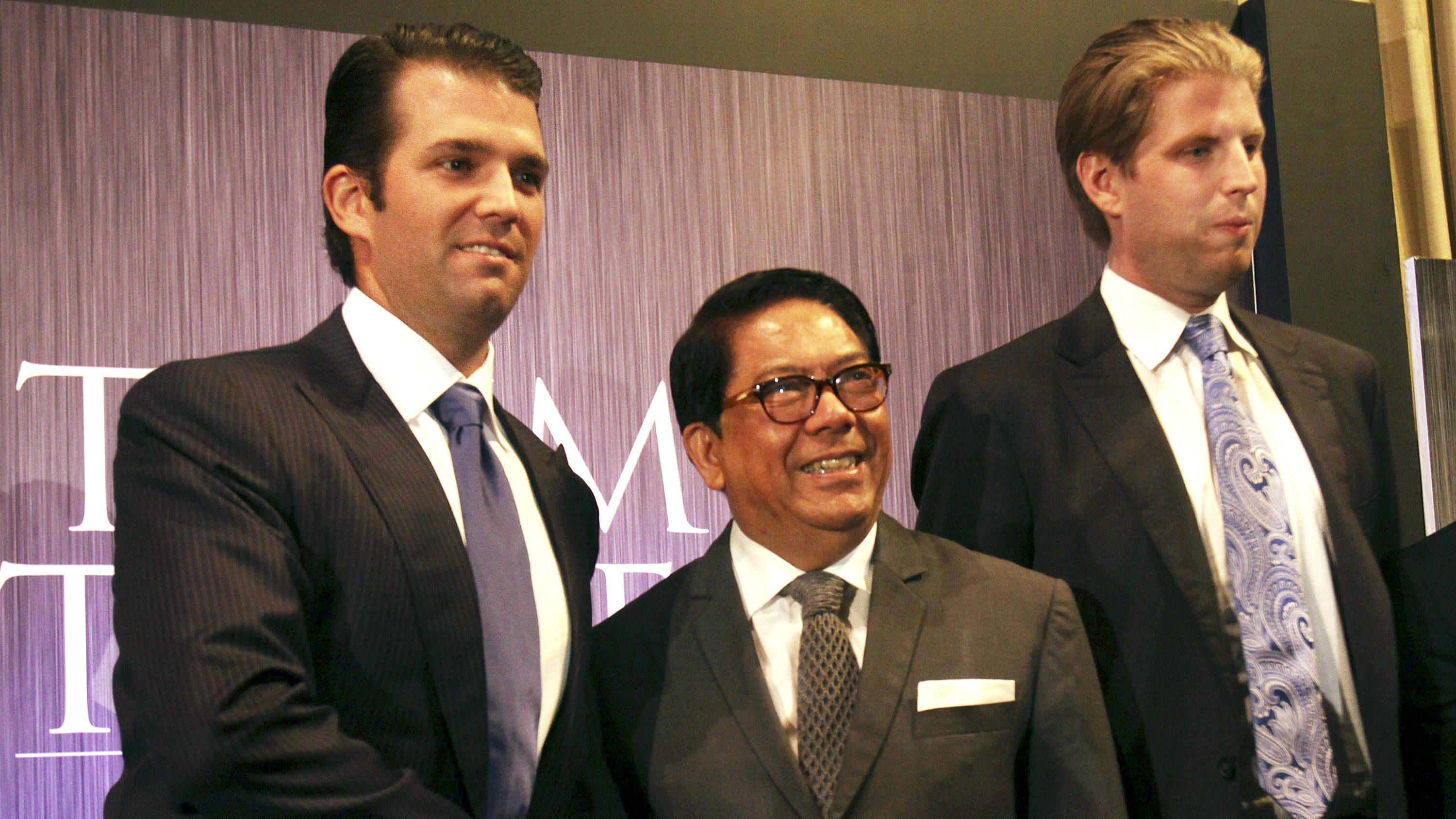Donald Trump Jr., left, and Eric Trump, right, sons of real estate developer Donald Trump, pose with local developer Jose E. B. Antonio during a press conference on the launching of Manila's Trump Tower project Tuesday, June 26, 2012 in the financial district of Makati, Philippines. The US$150-million, 56-story residential building using the brand name and mark under license from the New York-based Trump will be constructed by a local construction company.