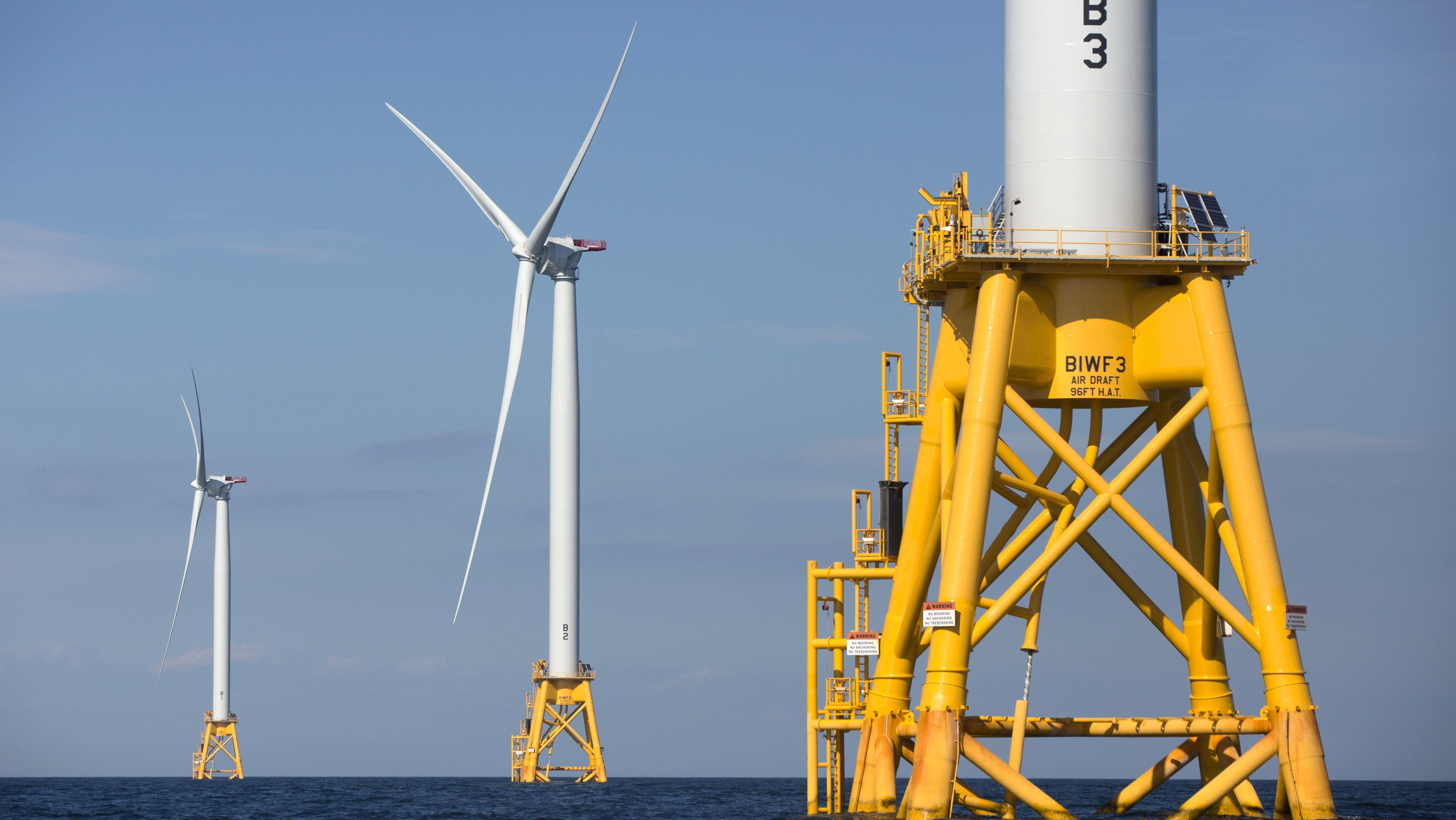 Three wind turbines from the Deepwater Wind project off Block Island, R.I., are viewed Monday, Aug. 15, 2016. Deepwater Wind's $300 million five-turbine wind farm off Block Island is expected to be operational this fall.(AP Photo/Michael Dwyer)