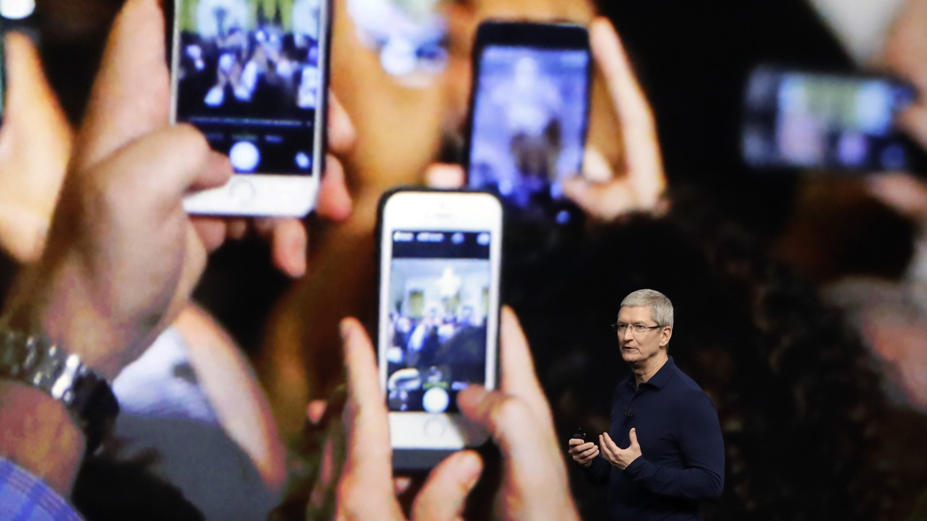 In this Wednesday, Sept. 7, 2016, file photo, Apple CEO Tim Cook announces the new iPhone 7 during an event to announce new products, in San Francisco. Apple reported Tuesday, Oct. 25, 2016, that it sold 45.5 million iPhones in the previous quarter, 5 percent fewer than it sold a year earlier. But the giant tech company's rosy forecast for the holidays was better than what Wall Street had been expecting.