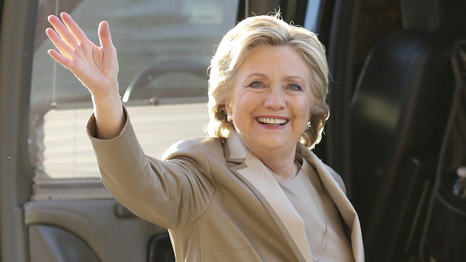 Democratic presidential candidate Hillary Clinton waves as she arrives to vote at her polling place in Chappaqua, N.Y., Tuesday, Nov. 8, 2016.