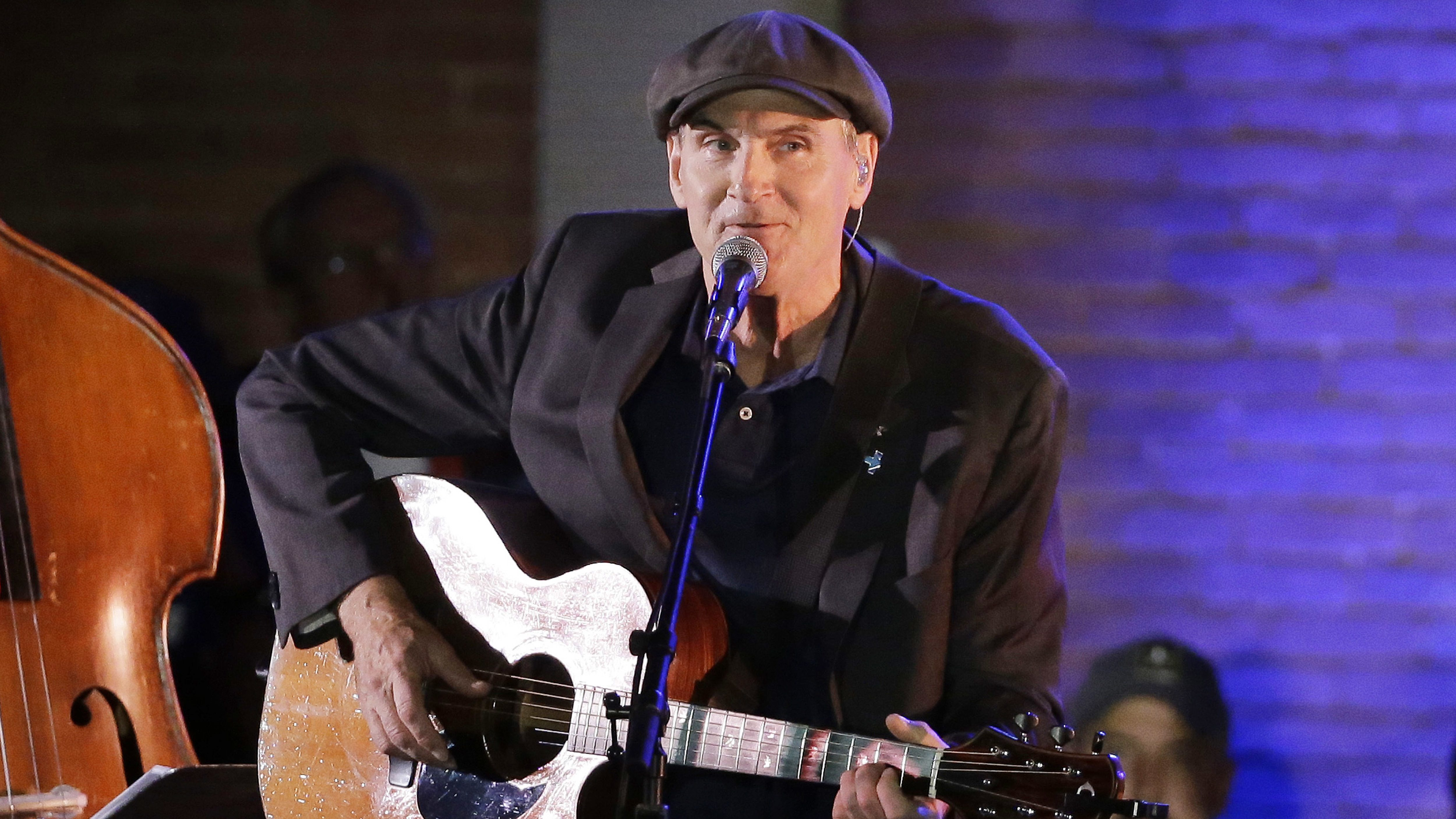 "In this Sunday, Nov. 6, 2016, file photo, musician James Taylor performs in Manchester, New Hampshire. James Taylor has canceled his February concert in Manila, saying he finds reports of summary executions of suspected drug offenders in the Philippines without judicial proceedings ""deeply concerning and unacceptable."""