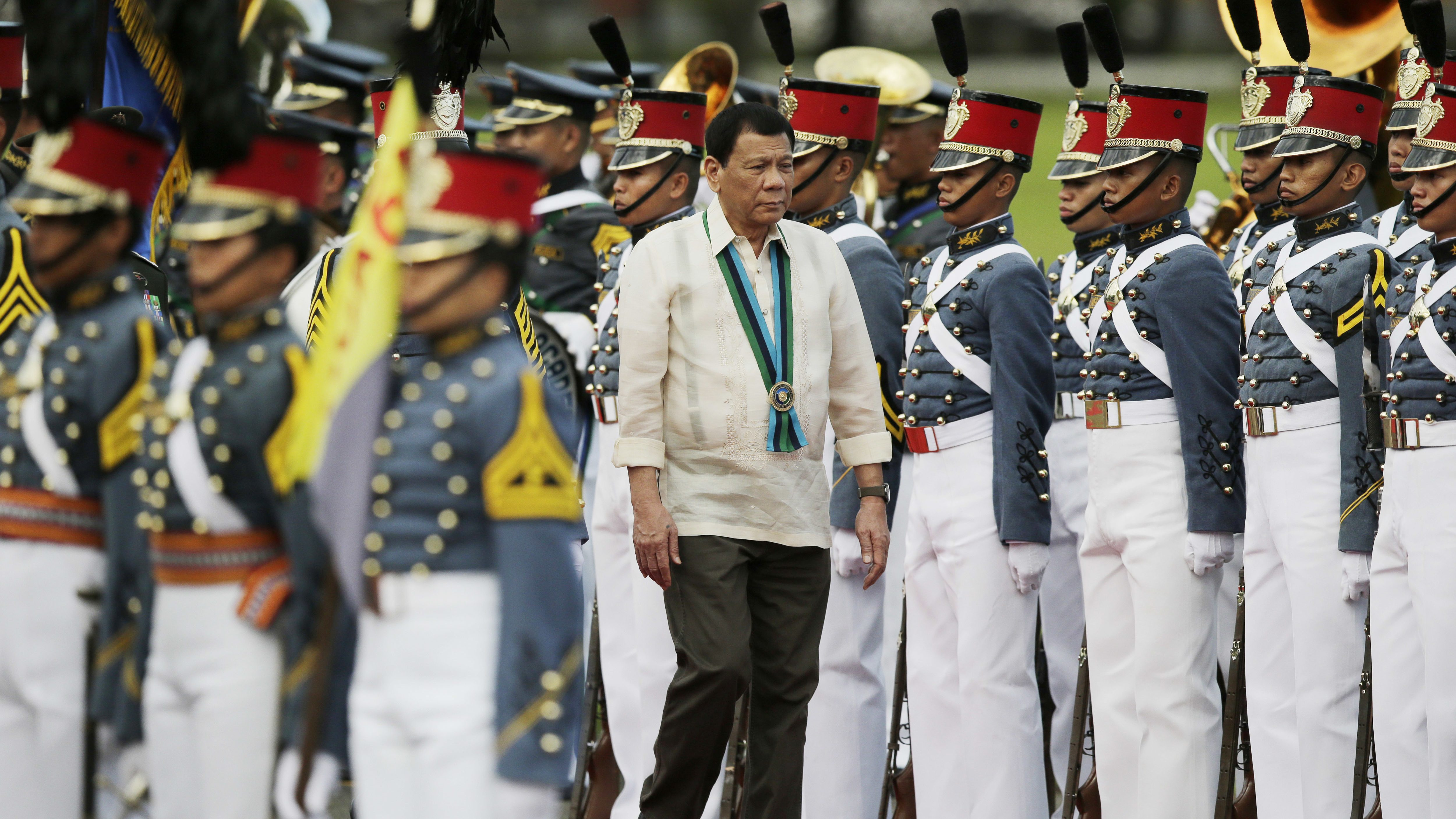 Philippine President Rodrigo Duterte inspects troops during the 81st anniversary of the Armed Forces of the Philippines at Camp Aguinaldo military headquarters in Quezon city, north of Manila, Philippines on Wednesday, Dec. 21, 2016.