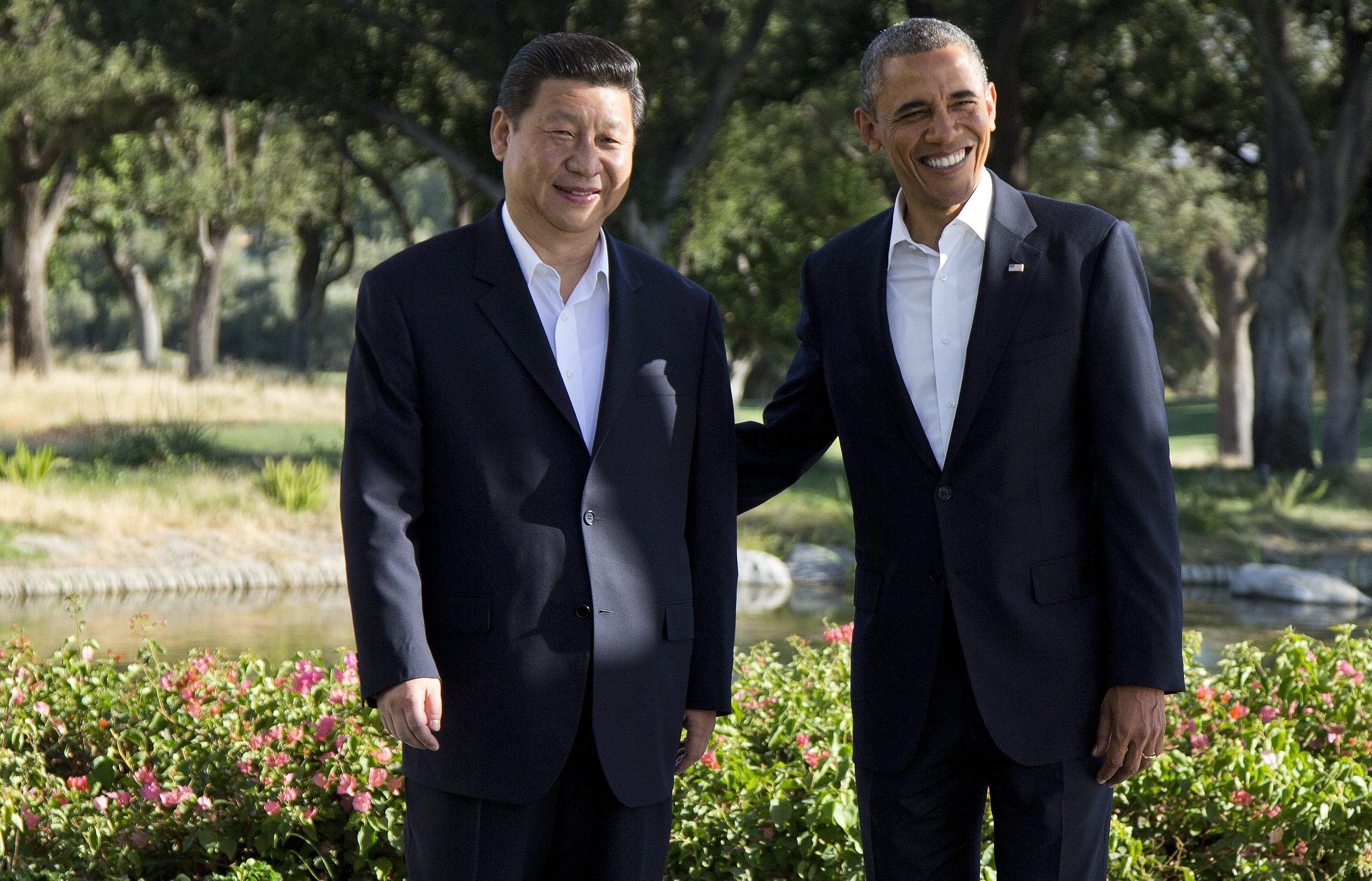 FILE - In this Friday, June 7, 2013, file photo, President Barack Obama poses with Chinese President Xi Jinping at the Annenberg Retreat at Sunnylands as they meet for talks in Rancho Mirage, Calif. Seeking a fresh start to a complex relationship, the two leaders are retreating to the sprawling desert estate for two days of talks on high-stakes issues, including cybersecurity and North Korea's nuclear threats. (AP Photo/Evan Vucci, File)