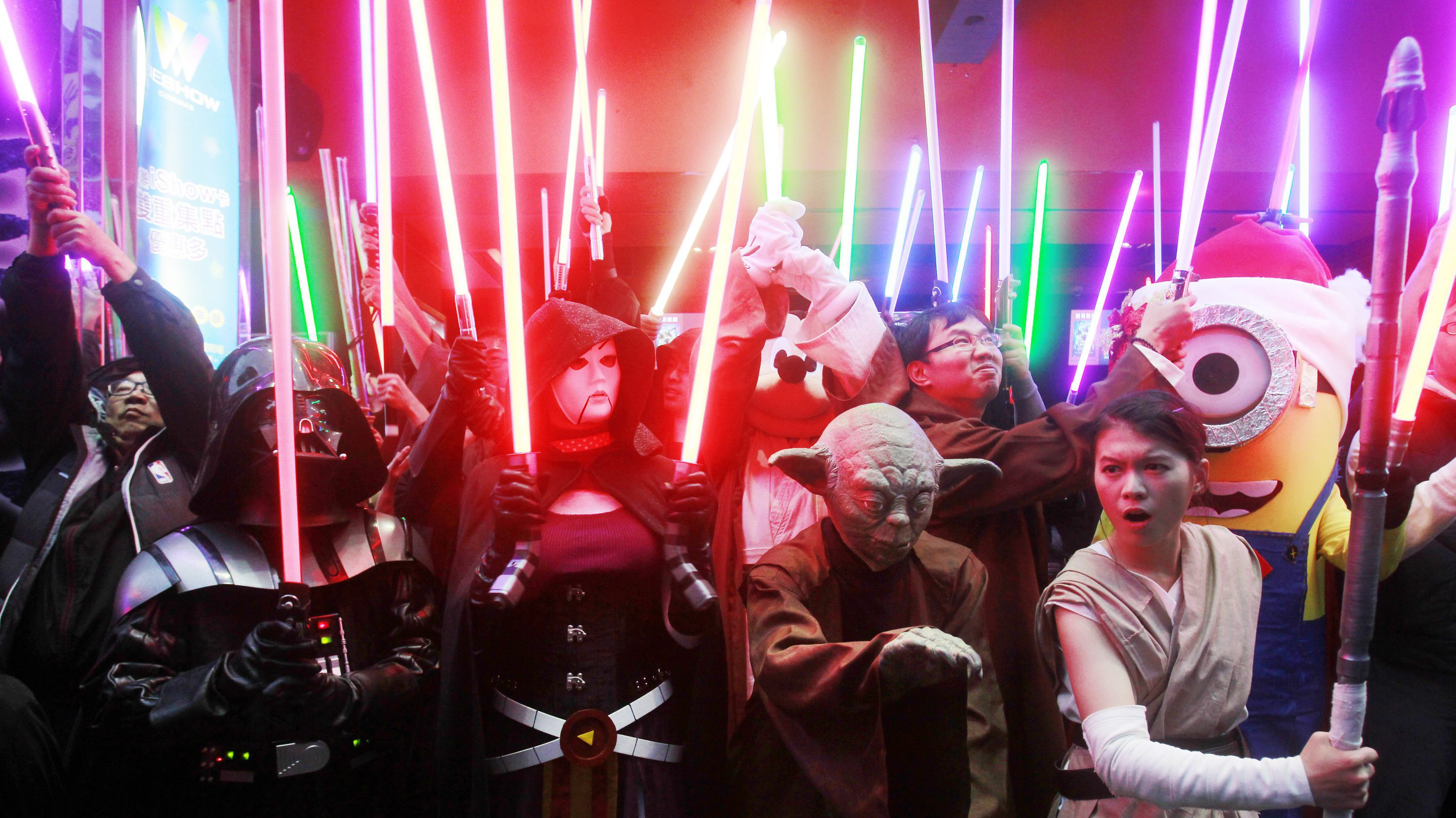 "Fans dressed as Star Wars characters parade outside a movie theater showing ""Star Wars: The Force Awakens"" Saturday, Dec. 19, 2015, in Taipei, Taiwan."