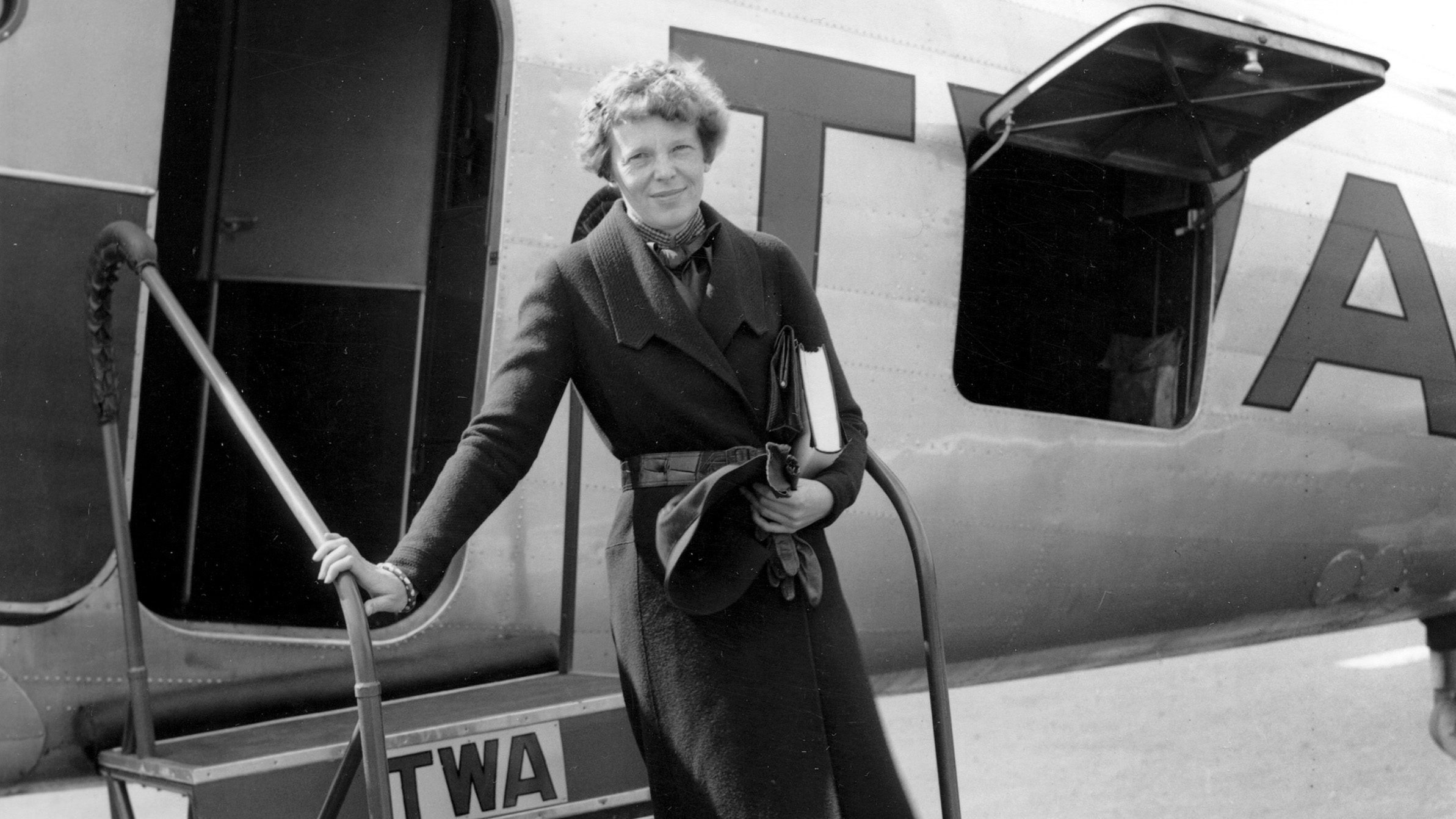 American aviatrix Amelia Earhart poses before boarding a TWA airplane at Newark Airport, N.J., May 22, 1935.  Earhart is en route to Chicago, Ill., to address the Chicago Women's Club.  (AP Photo)