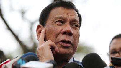 Philippine presidential candidate Rodrigo Duterte gestures as he answers questions from reporters at the University of the Philippines in suburban Quezon city, north of Manila, Philippines, Thursday, Feb. 18, 2016. Five candidates are running for President in the coming elections this May