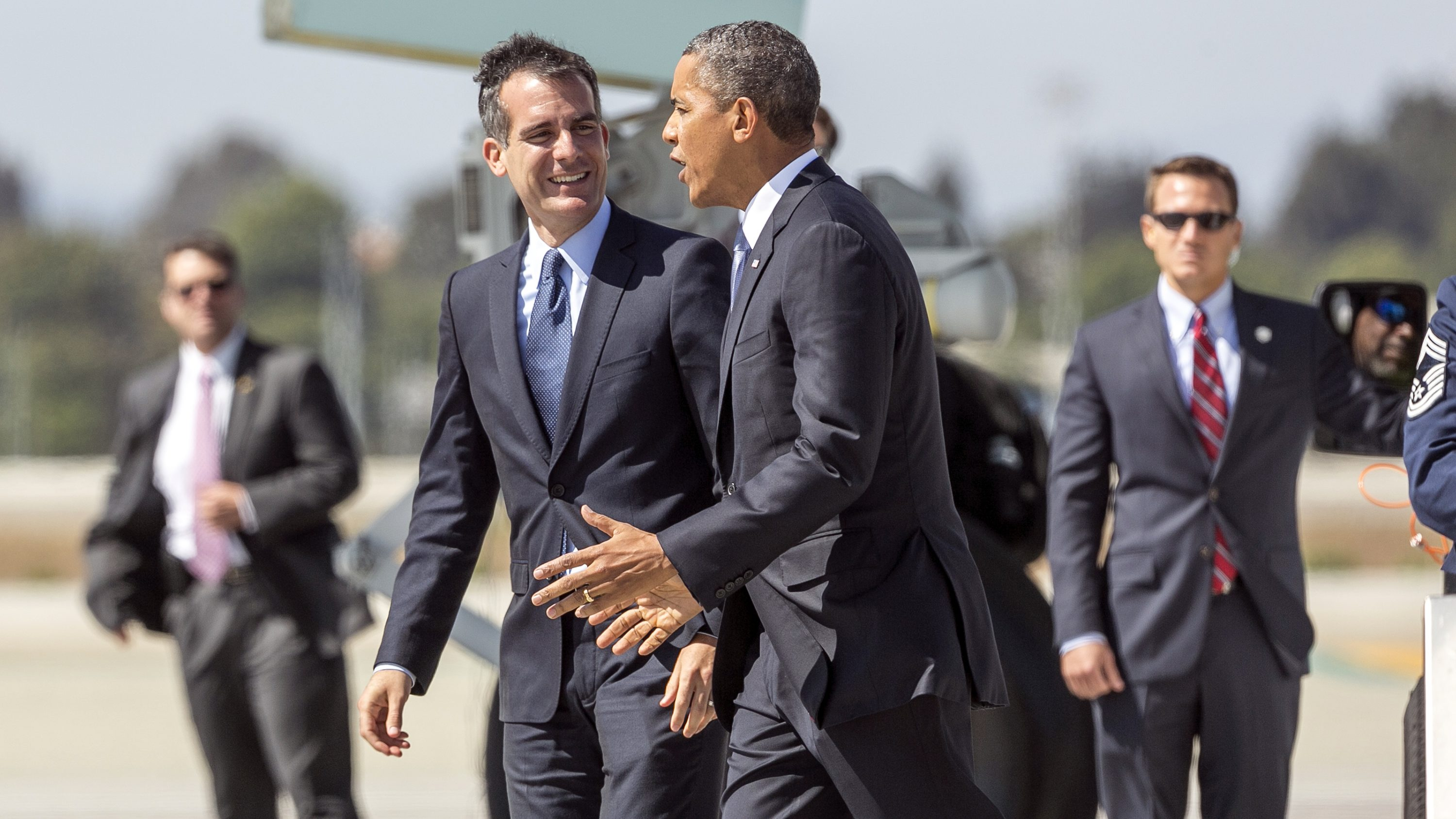 President Barack Obama is welcomed by Los Angeles Mayor Eric Garcetti, left, as he steps off of Air Force One at Los Angeles International Airport Tuesday, Aug. 6, 2013, in Los Angeles. (AP Photo/Damian Dovarganes)