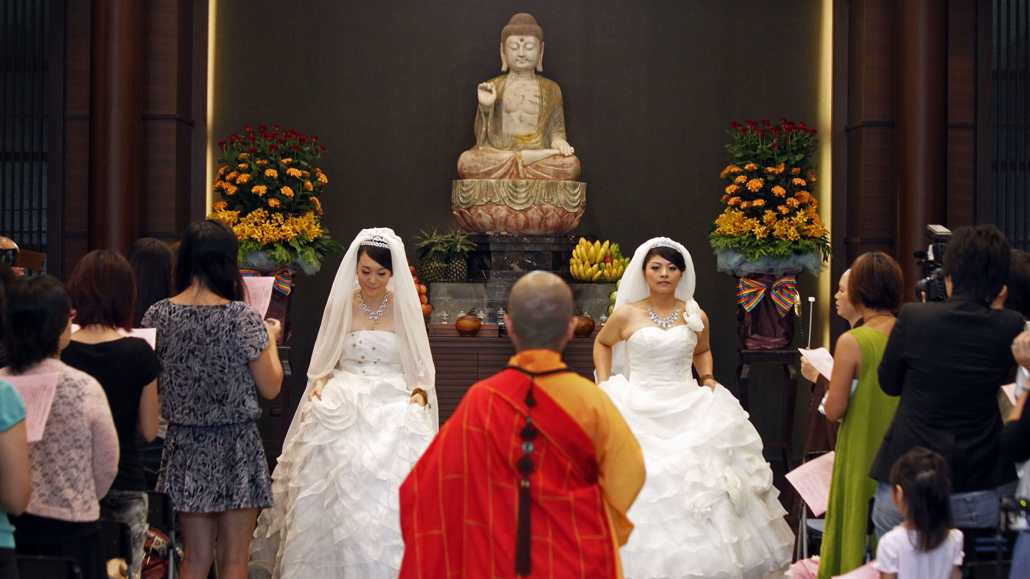 A same-sex couple are married by a nun in the first same-sex Buddhist ceremonial wedding in Taoyuan, Taiwan, Aug. 11, 2012.
