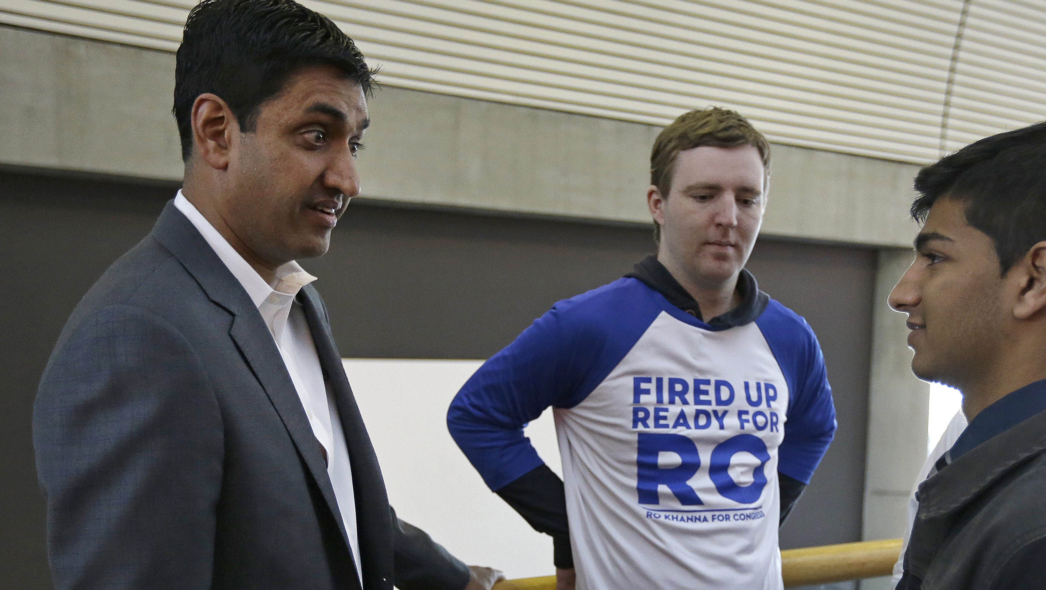 Ro Khanna, left, Democratic candidate for U.S. Representative from California's 17th District, speaks with supporters during a break in the California Democrats State Convention Saturday, Feb. 27, 2016, in San Jose, Calif. (AP Photo/)
