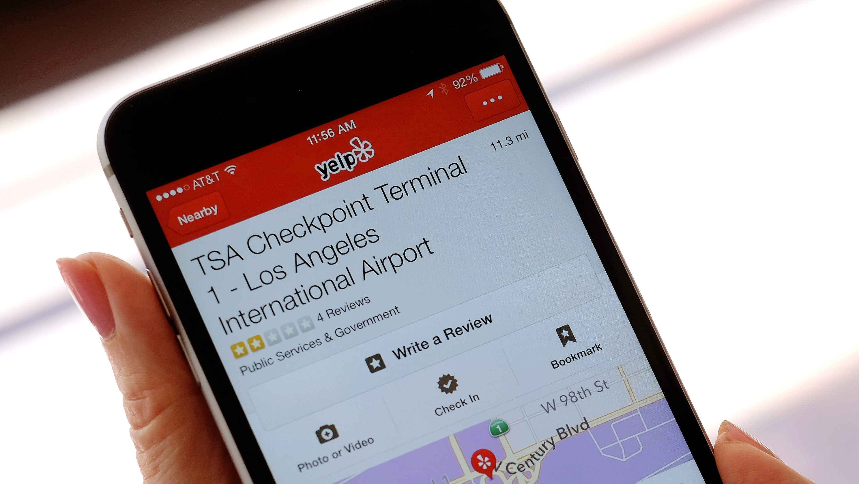 The mobile view of the Yelp site application shown on an iPhone mobile, shows the TSA Checkpoint Terminal 1 at the Los Angeles International Terminal location in Los Angeles on Tuesday, Aug. 18, 2015. Frustrated travelers have already been turning to the popular site for years to vent about the long, slow-moving airport security lines, intrusive body scans and questioning of agents. The General Service Administration unveiled last week that it had reached a deal with Yelp so the public can rate federal agencies, from the Transportation Safety Administration to national parks. (AP Photo/Richard Vogel)