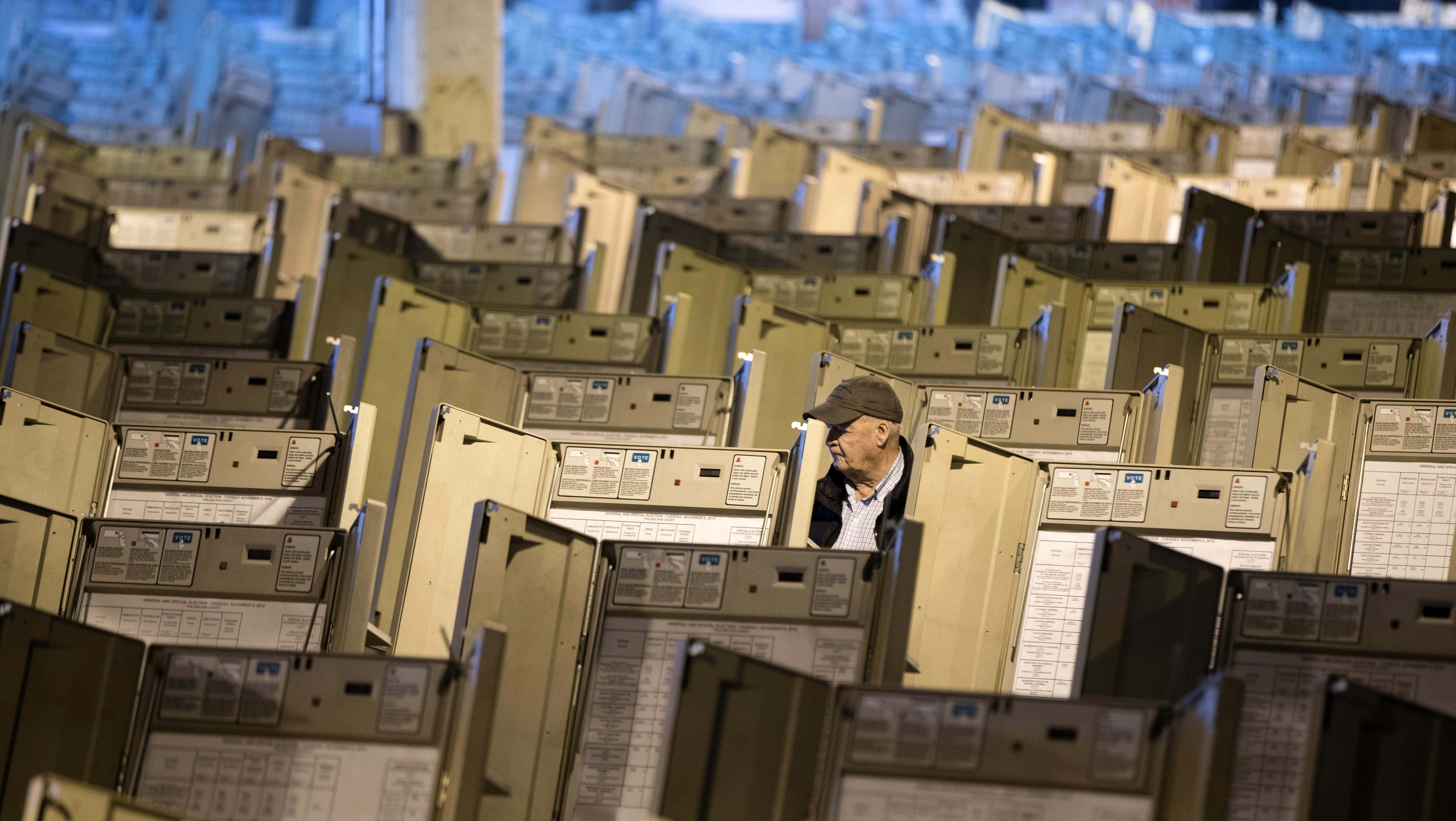 A technician works to prepare voting machines to be used in the upcoming presidential election, in Philadelphia, Friday, Oct. 14, 2016. (AP Photo/Matt Rourke)