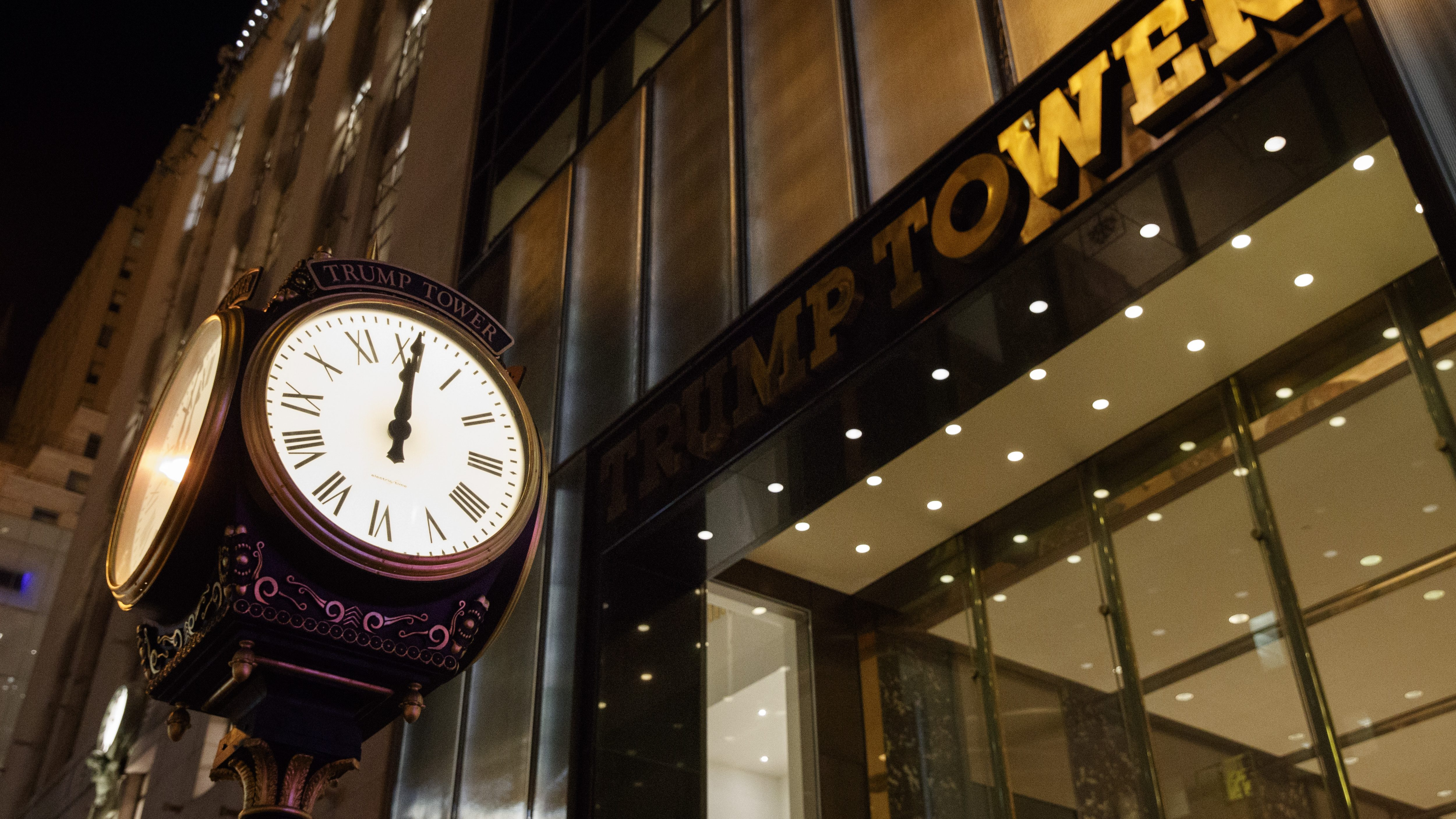 A clock sits outside of Trump Tower at midnight on, Saturday, Oct. 8, 2016, in New York. Republican presidential candidate Donald Trump blurted out lewd and sexually charged comments about women as he waited to make a cameo appearance on a soap opera in 2005, a revelation that led him to issue a rare apology.