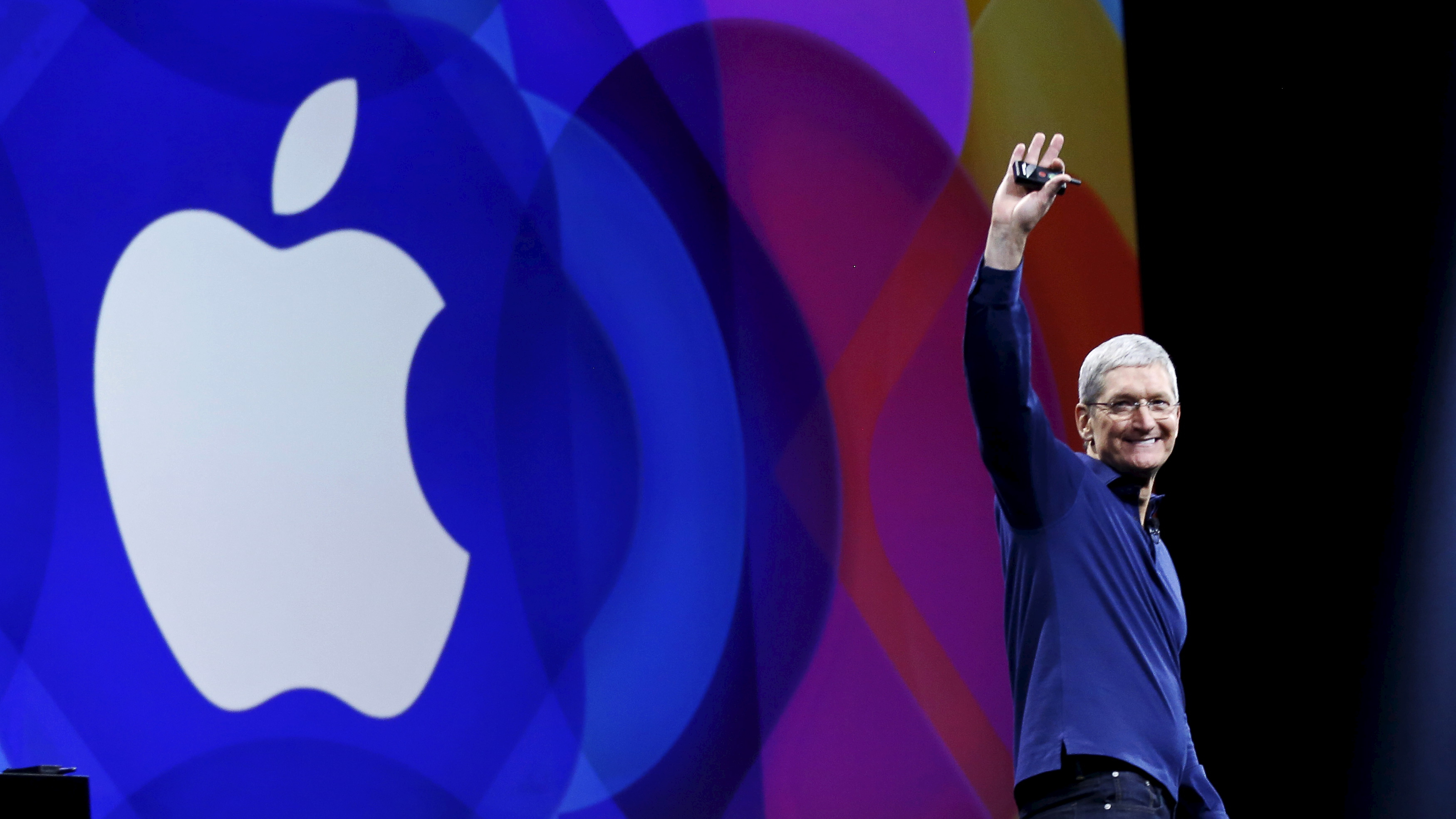 Apple CEO Tim Cook waves as he arrives on stage to deliver his keynote address at the Worldwide Developers...