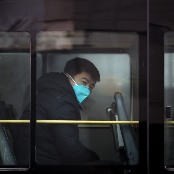 A man wearing a mask for protection against air pollution looks out from a bus in Beijing as the capital of China is shrouded by heavy smog on Tuesday, Dec. 20, 2016. Thick, gray smog fell over Beijing on Tuesday, clouding China's capital in a haze that spurred authorities to cancel flights and close some highways in emergency measures to cut down on air pollution. (AP Photo/Andy Wong)