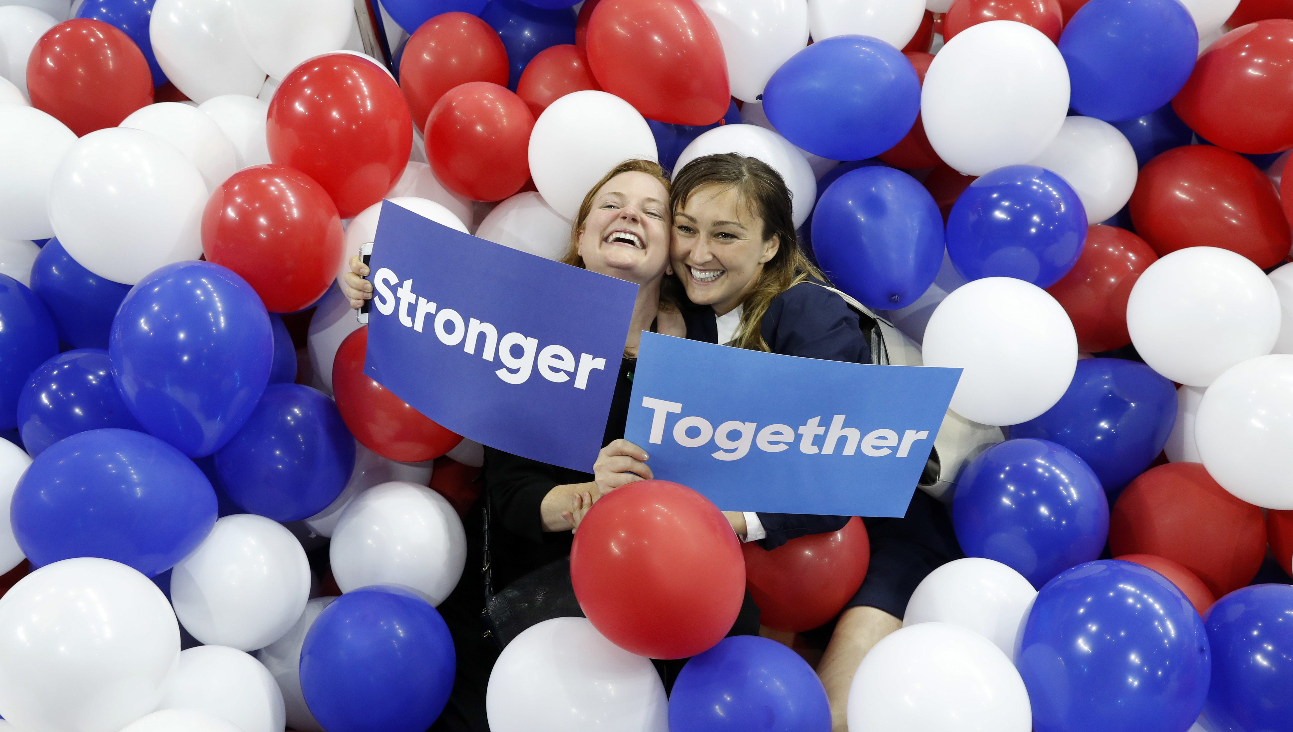 Campaign staffers for Democratic presidential nominee Hillary Clinton pose in balloons on the floor after the Democratic National Convention in Philadelphia, Thursday, July 28, 2016.