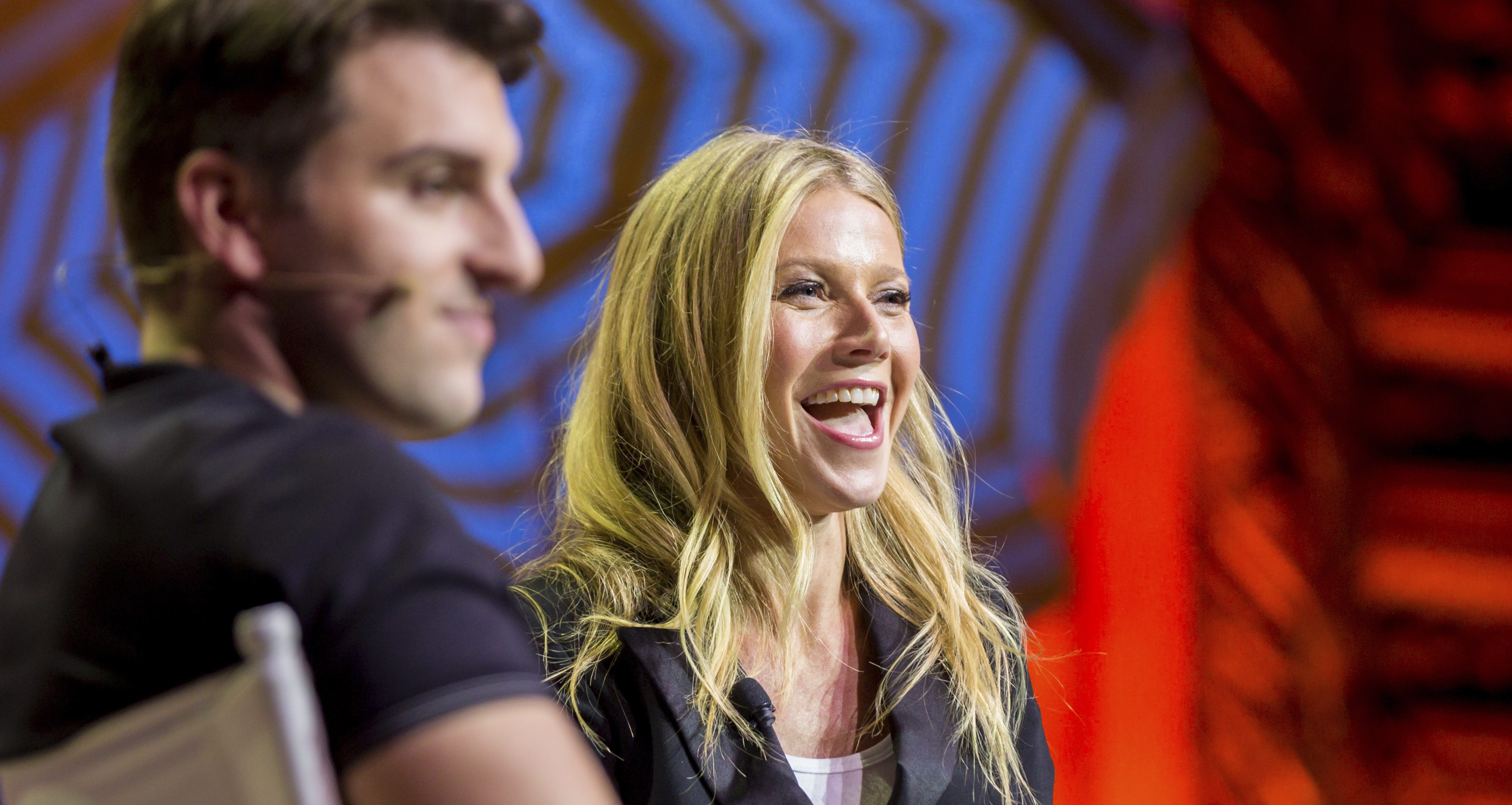 Gwyneth Paltrow, right, and Airbnb CEO Brian Chesky speak at a panel during the Airbnb Open Spotlight at The Orpheum Theatre on Saturday, Nov. 19, 2016, in Los Angeles. (Photo by Willy Sanjuan/Invision/AP)