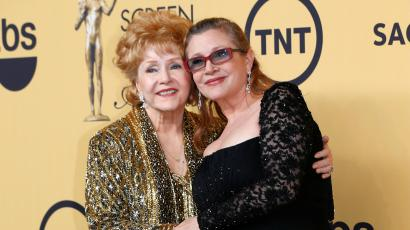 Actress Debbie Reynolds poses with her daughter actress Carrie Fisher backstage after accepting her Lifetime Achievement award at the 21st annual Screen Actors Guild Awards in Los Angeles