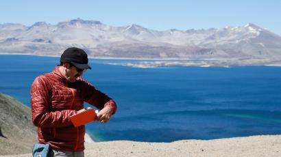 An American geologist takes notes in Chile.