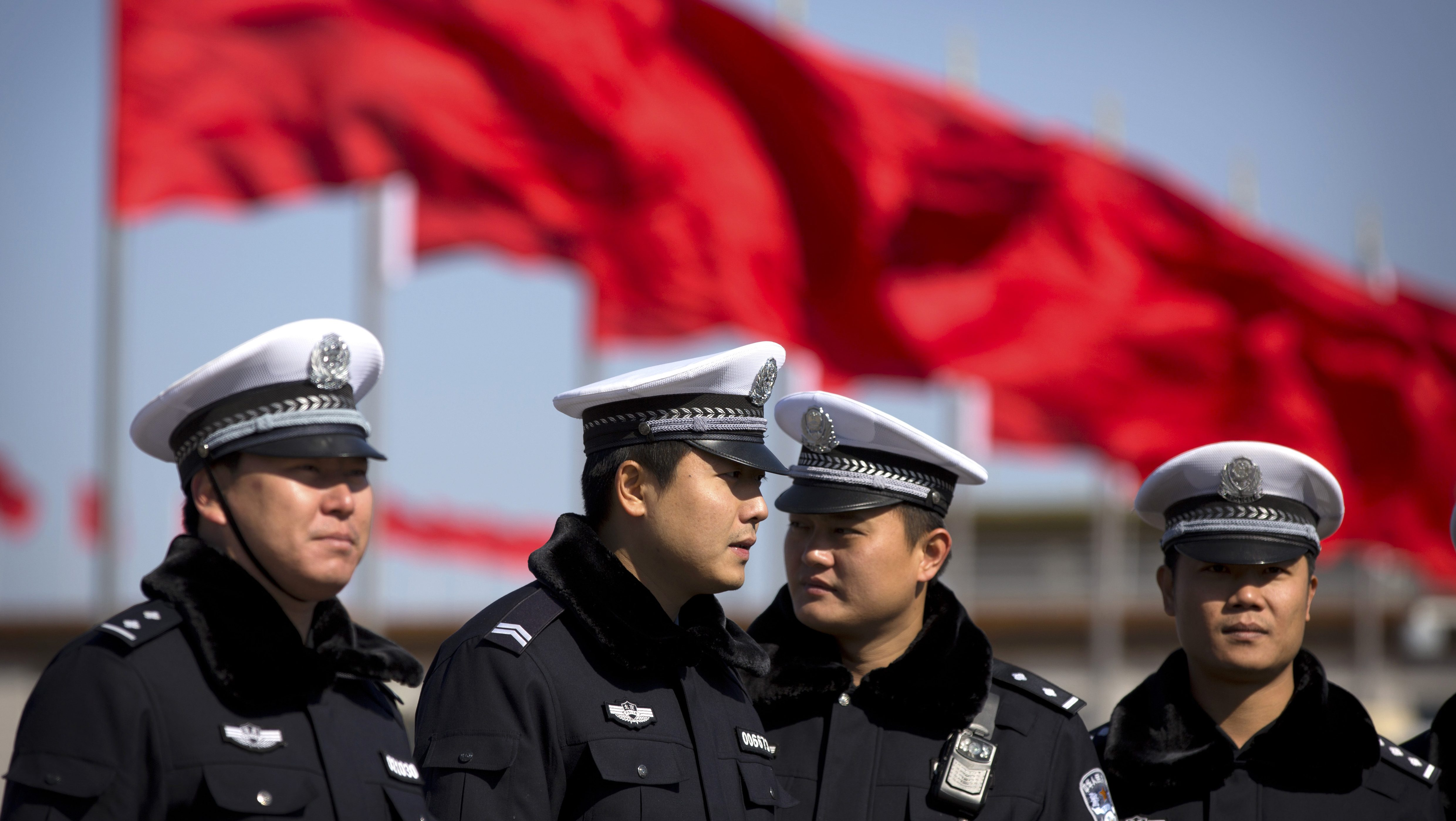 Chinese policemen gather on Tiananmen Square before delegates arrive for the opening session of the Chinese People's Political Consultative Conference in Beijing's Great Hall of the People, Tuesday, March 3, 2015. The more than 2,000 members of China's top legislative advisory body convened their annual meeting Tuesday, kicking off a political high season that will continue with the opening of the national congress later in the week. (AP Photo/Mark Schiefelbein)