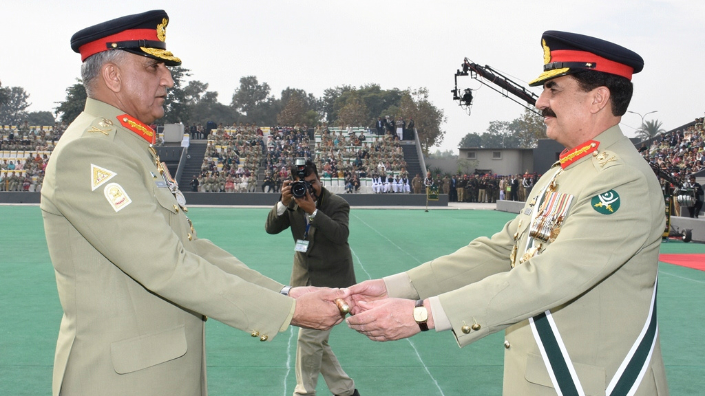 Pakistan's outgoing Army Chief Gen. Raheel Sharif (R) hands over a ceremonial baton to his successor Gen. Qamar Javed Bajwa during the Change of Command ceremony in Rawalpindi, Pakistan, November 29, 2016.