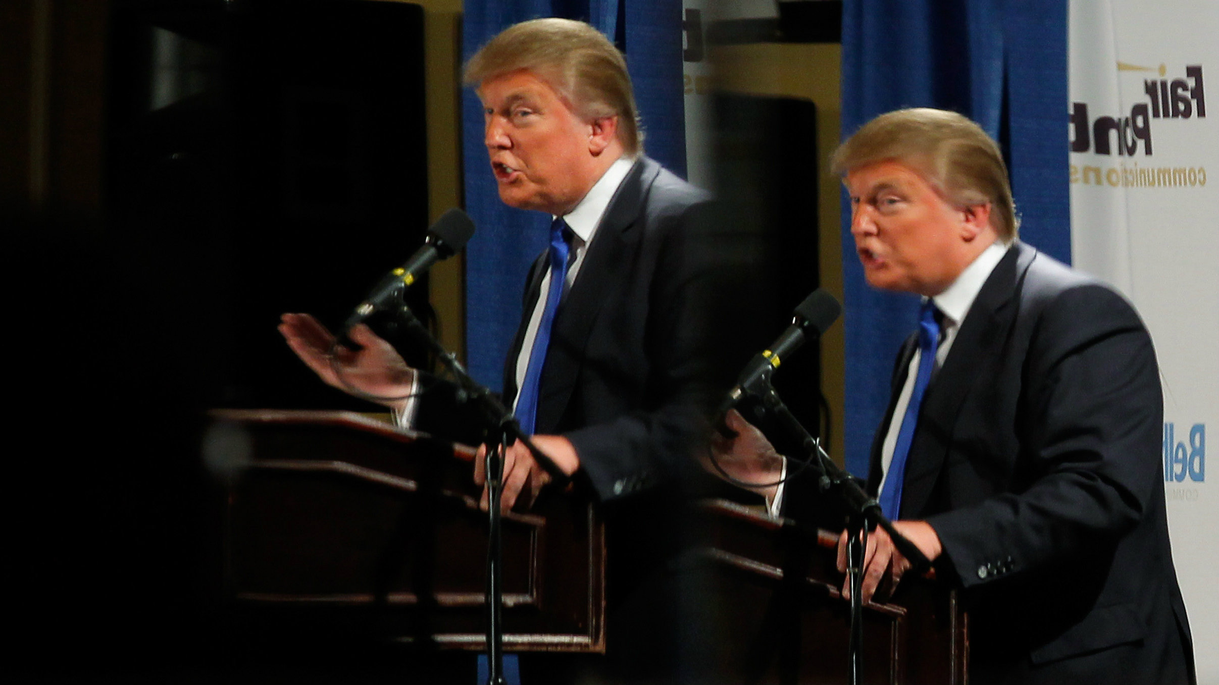 Businessman and possible Republican Presidential candidate Donald Trump is reflected in mirrors while speaking at the Greater Nashua Chamber of Commerce Expo in Nashua, New Hampshire May 11, 2011. REUTERS/Brian Snyder (UNITED STATES - Tags: POLITICS BUSINESS)