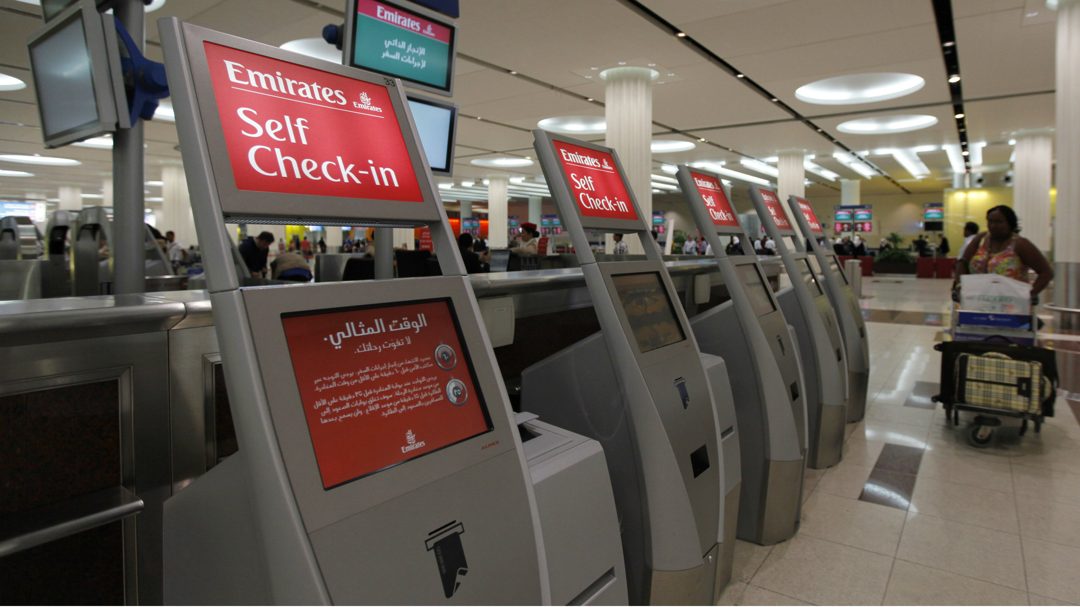Self check-in kiosks are seen at the Emirates Airlines departures terminal at Dubai International Airport, February 6, 2012.