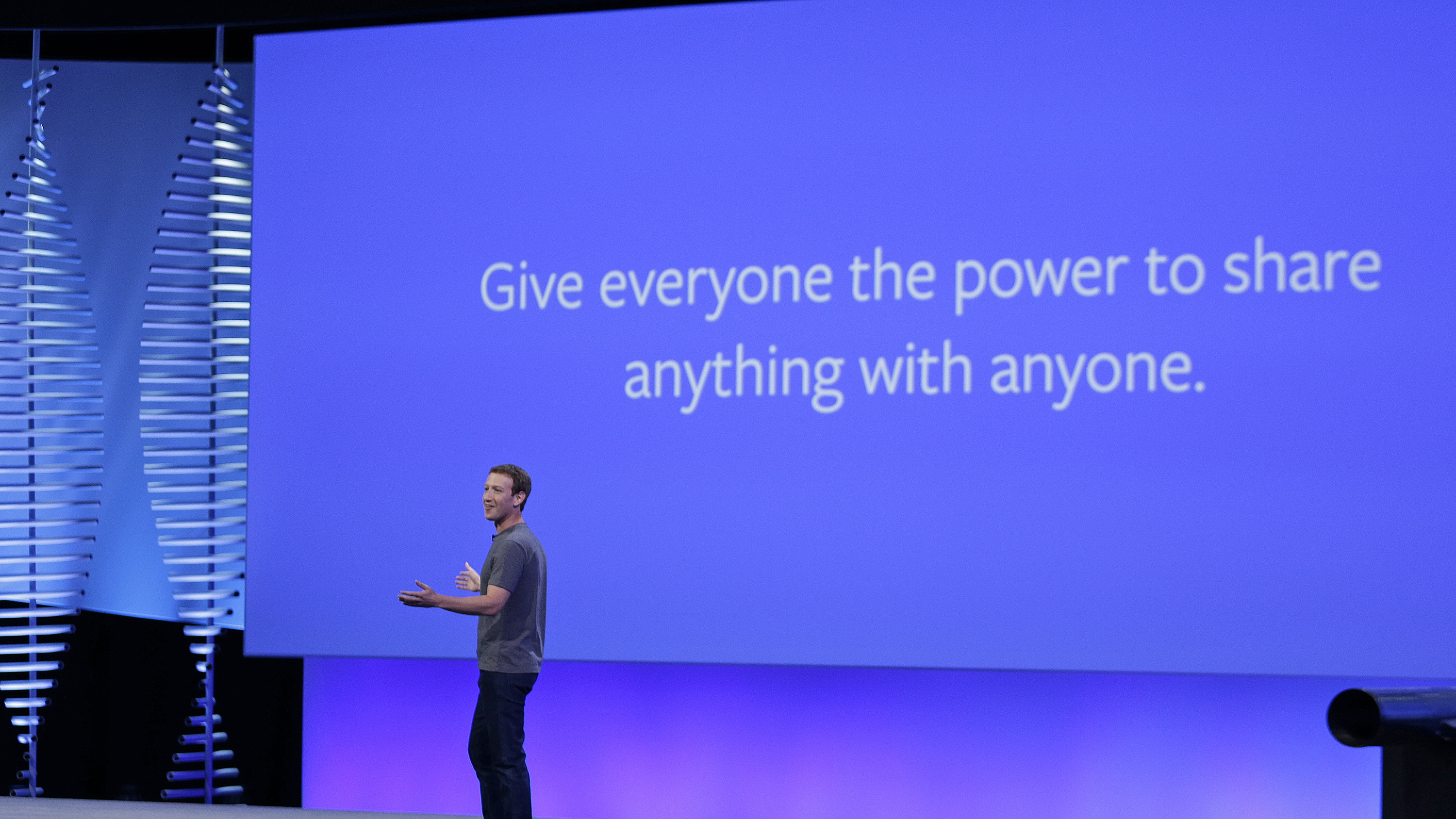 "Facebook CEO Mark Zuckerberg during the keynote address at the F8 Facebook Developer Conference Tuesday, April 12, 2016, in San Francisco. Facebook says people who use its Messenger chat service will soon be able to order flowers, request news articles and talk with businesses by sending them direct text messages. At its annual conference for software developers, Zuckerberg said the company is releasing new tools that businesses can use to build ""chat bots,"" or programs that talk to customers in conversational language. (AP Photo/Eric Risberg)"